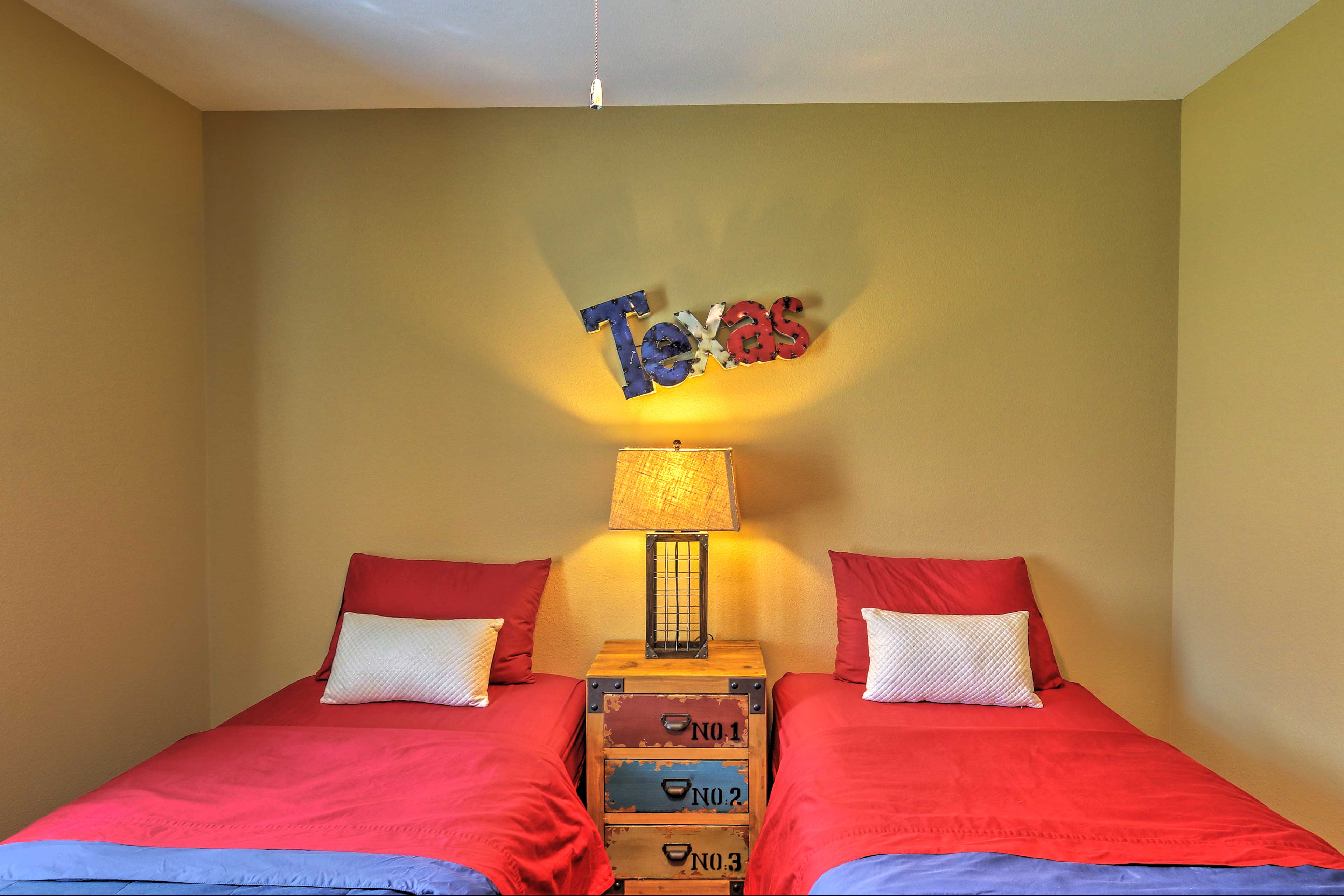 Drift off to dreamland in the fourth bedroom, which features 2 twin beds.