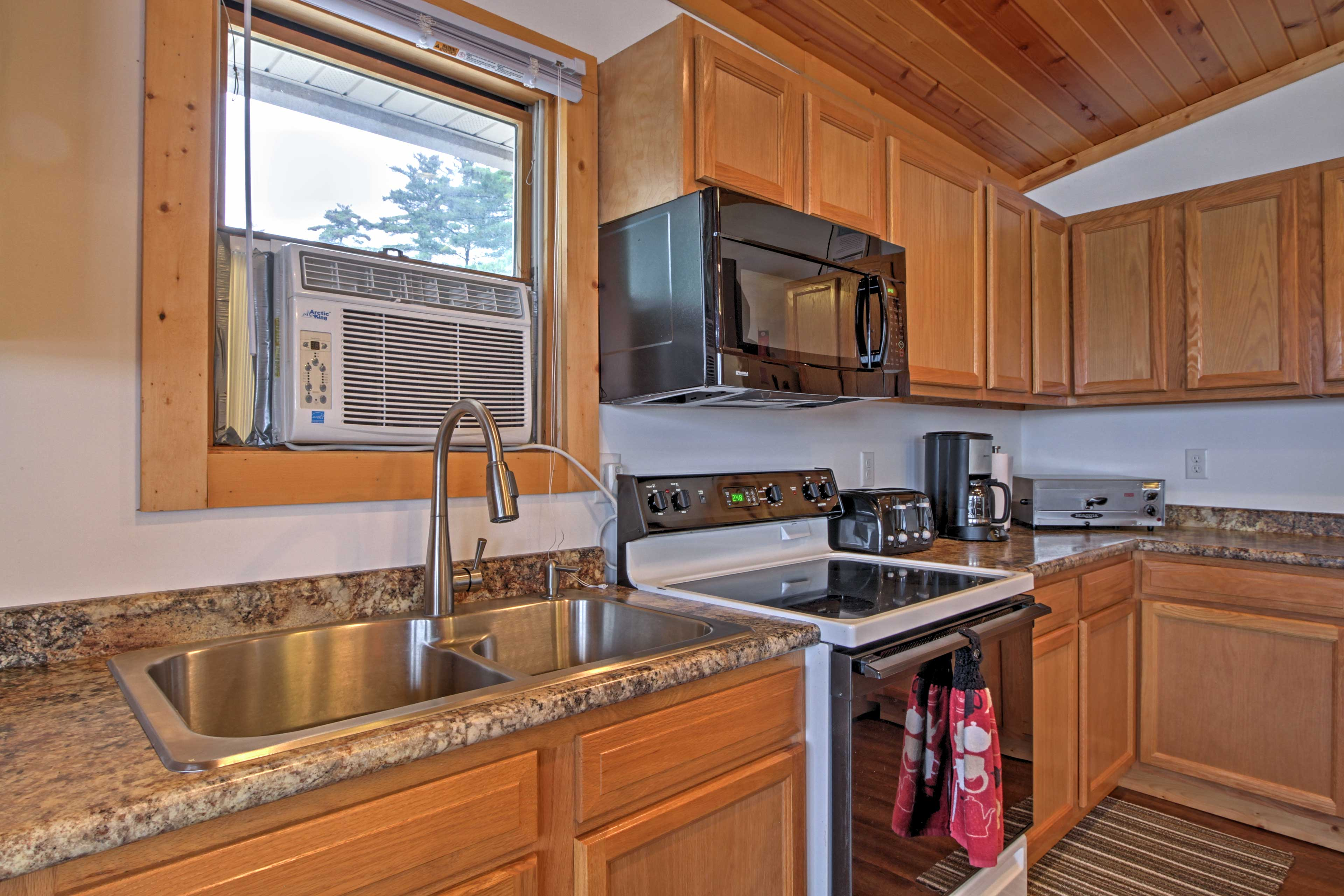 Cook at home with ease in the fully equipped kitchen with modern appliances.