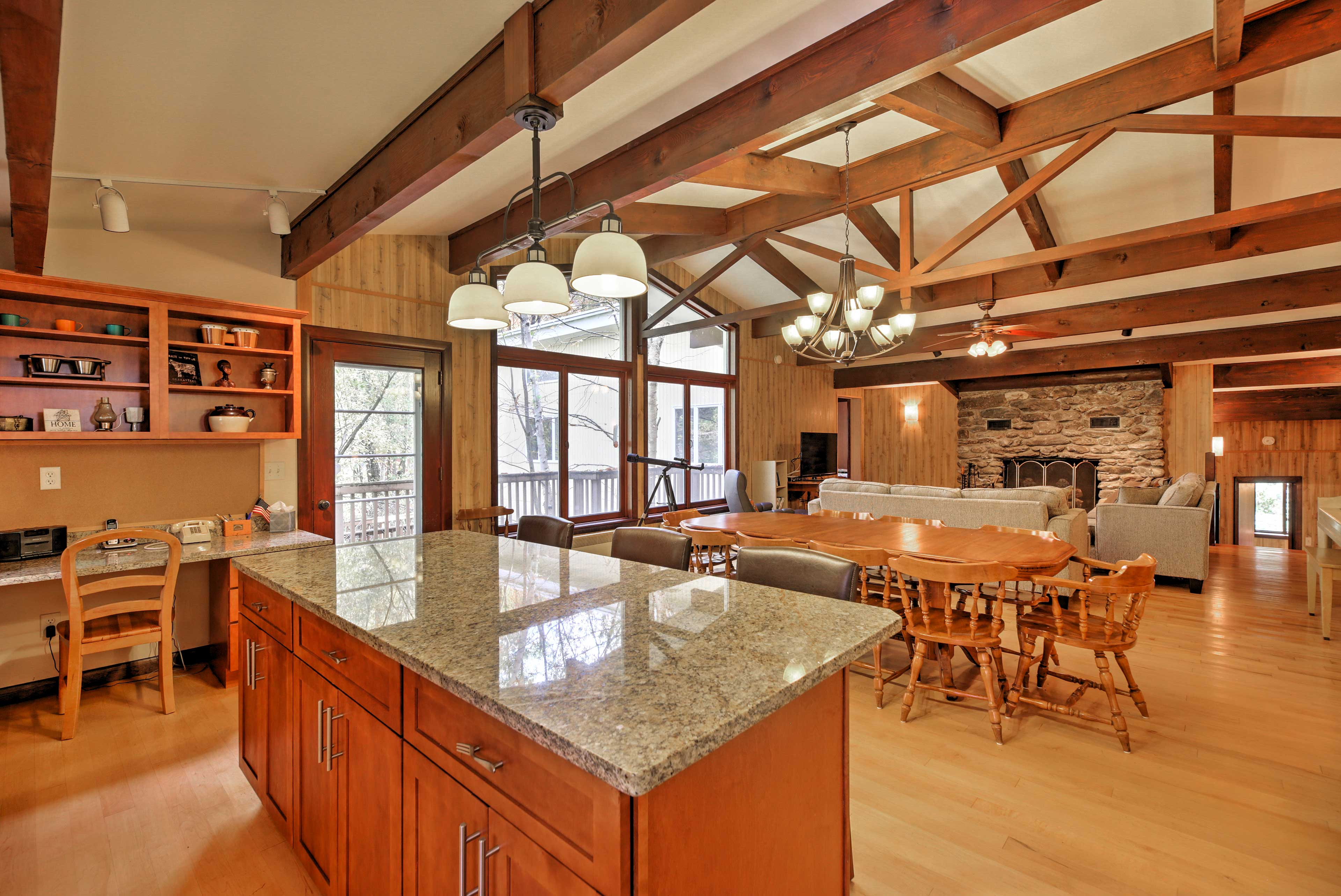 The fully equipped kitchen features granite countertops and a large island.