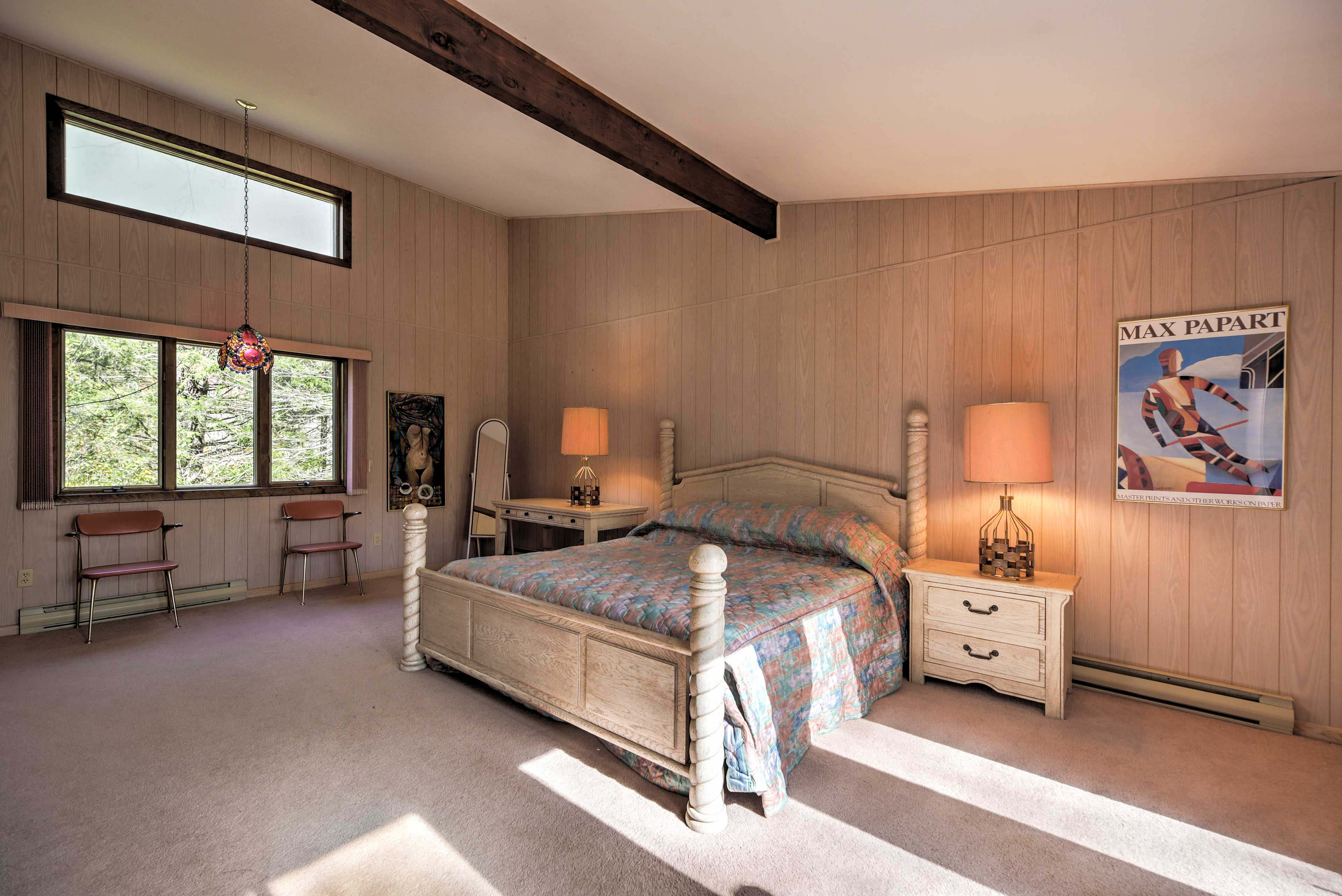 Cozy up on this king-sized bed in the master bedroom.