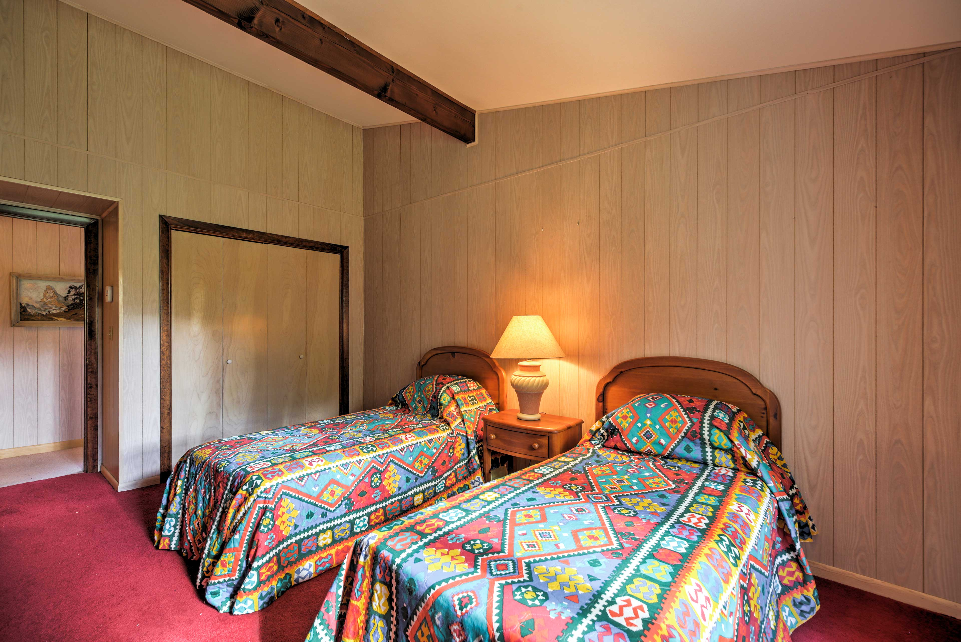 Two guests can enjoy peaceful slumbers on these twin beds.