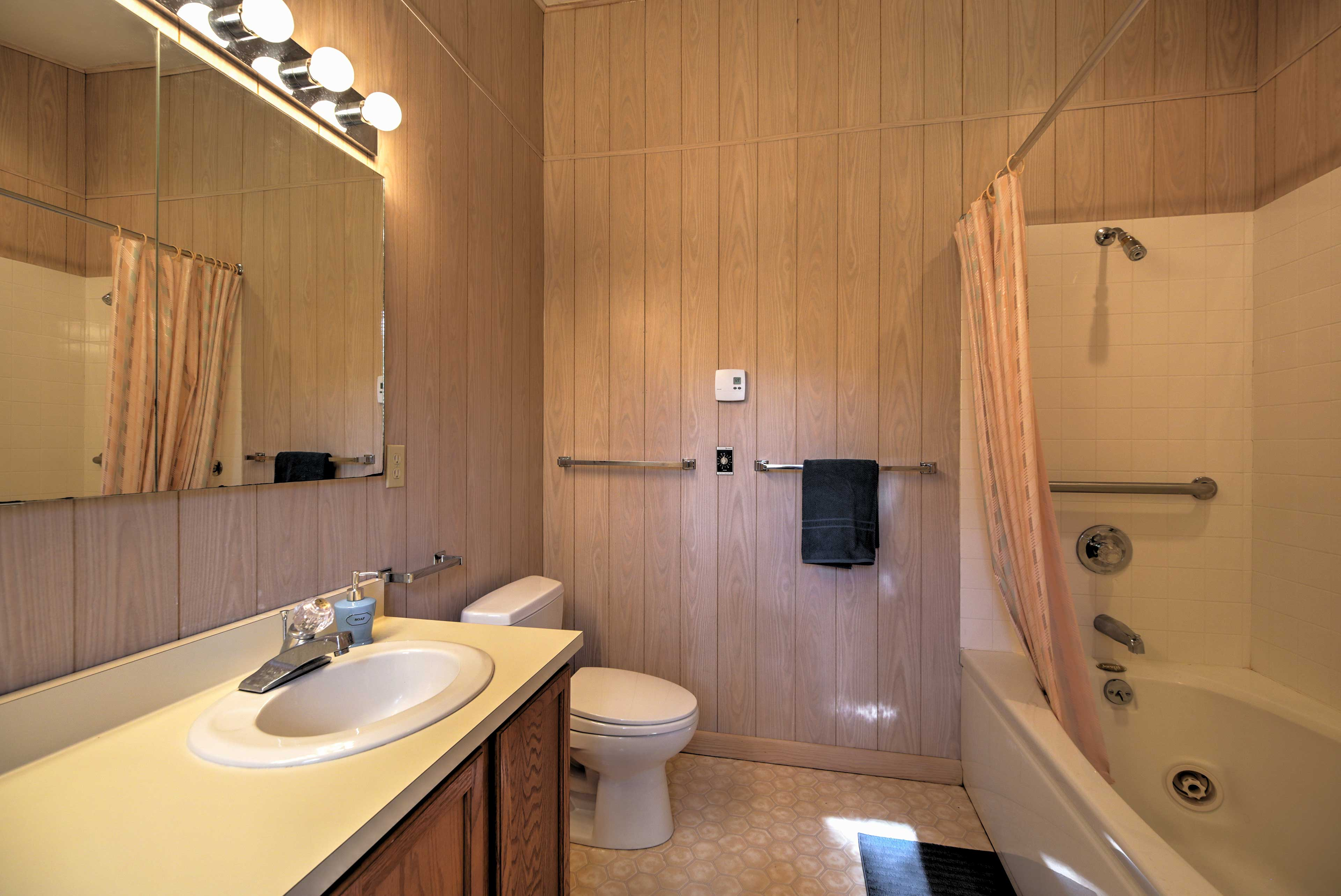Freshen up for the day in this bathroom that includes a shower/tub combo.