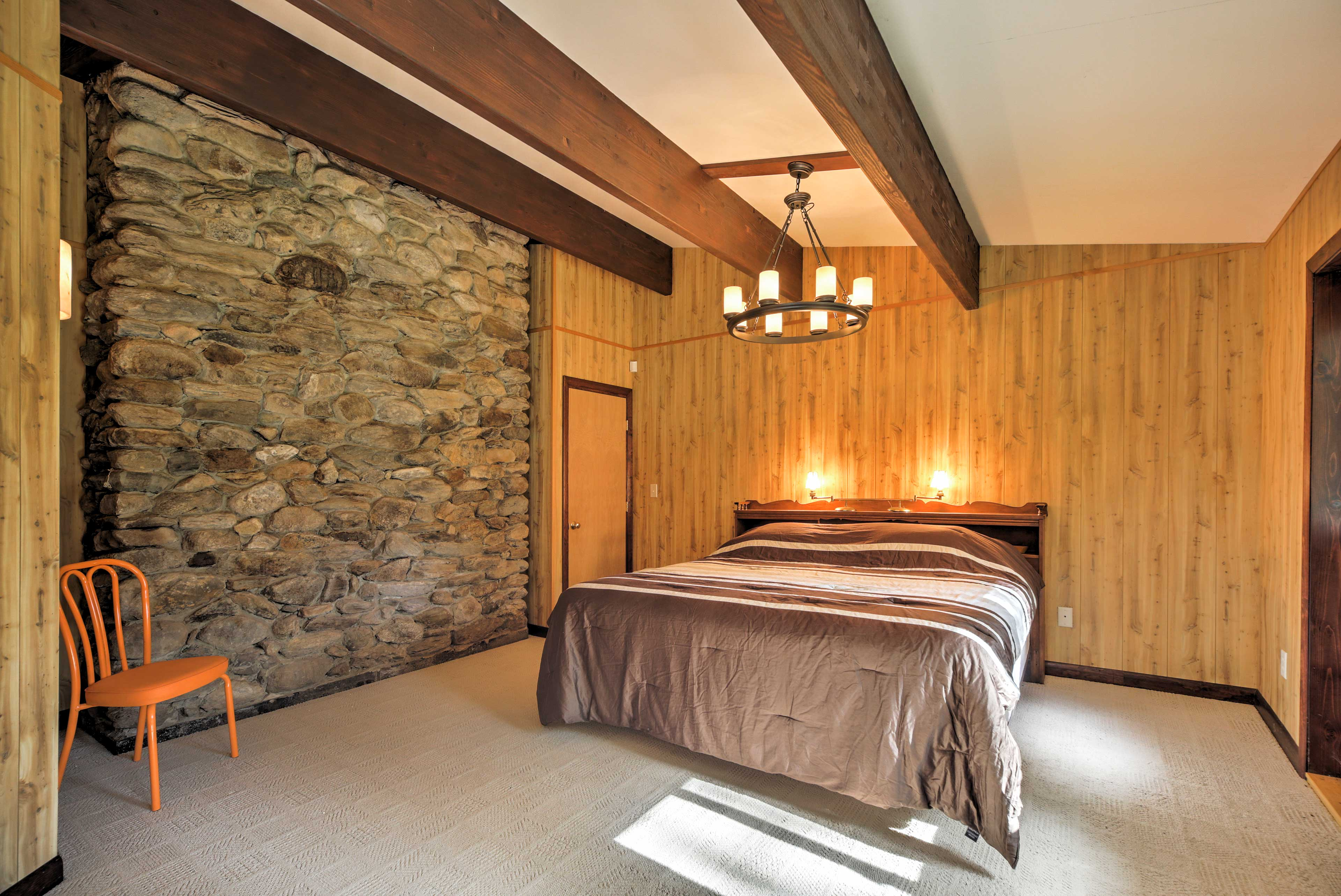 Relax in this king-sized bed and admire the river rock and exposed beam accents.