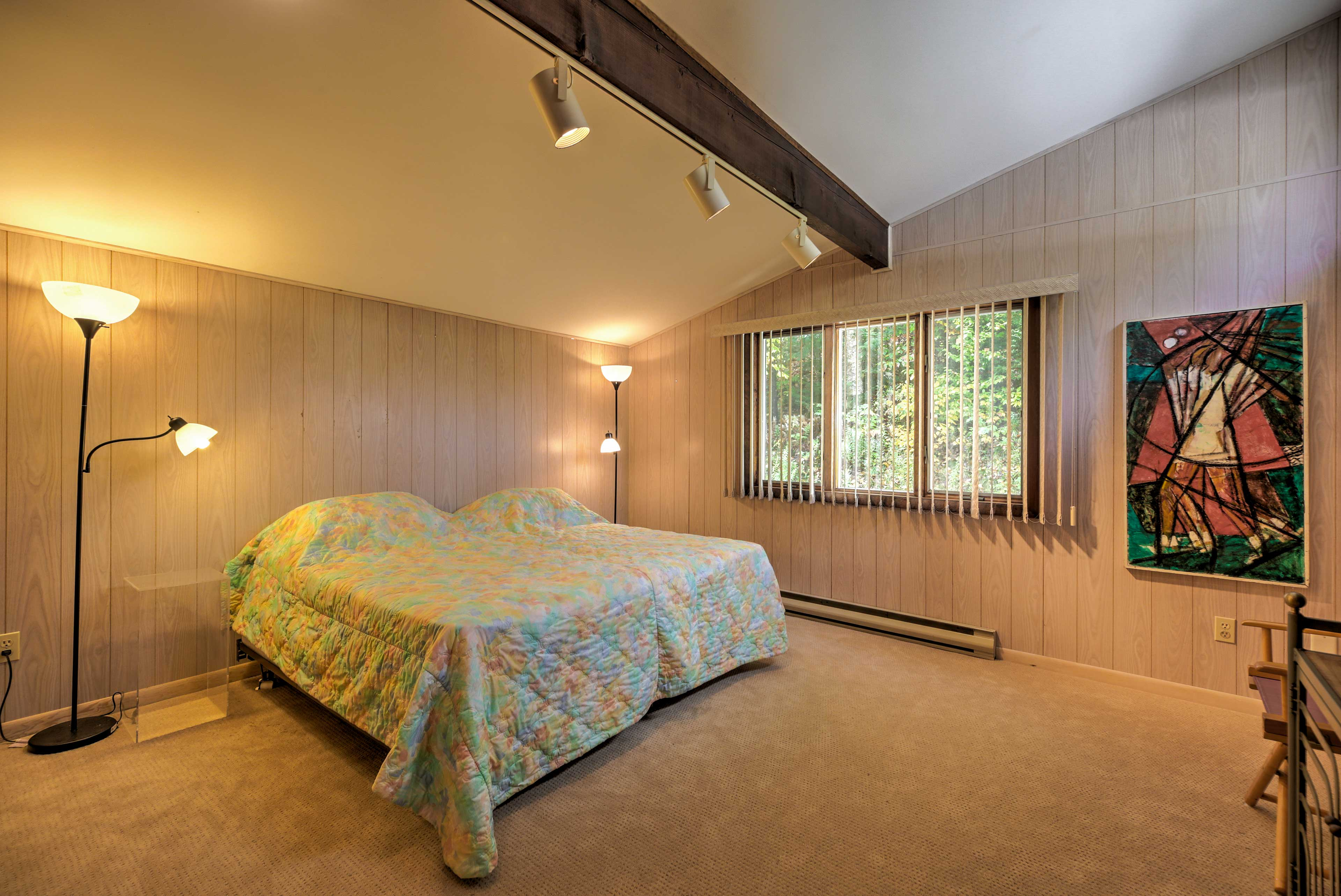 This bedroom provides 2 twin beds that are arranged to form a king.
