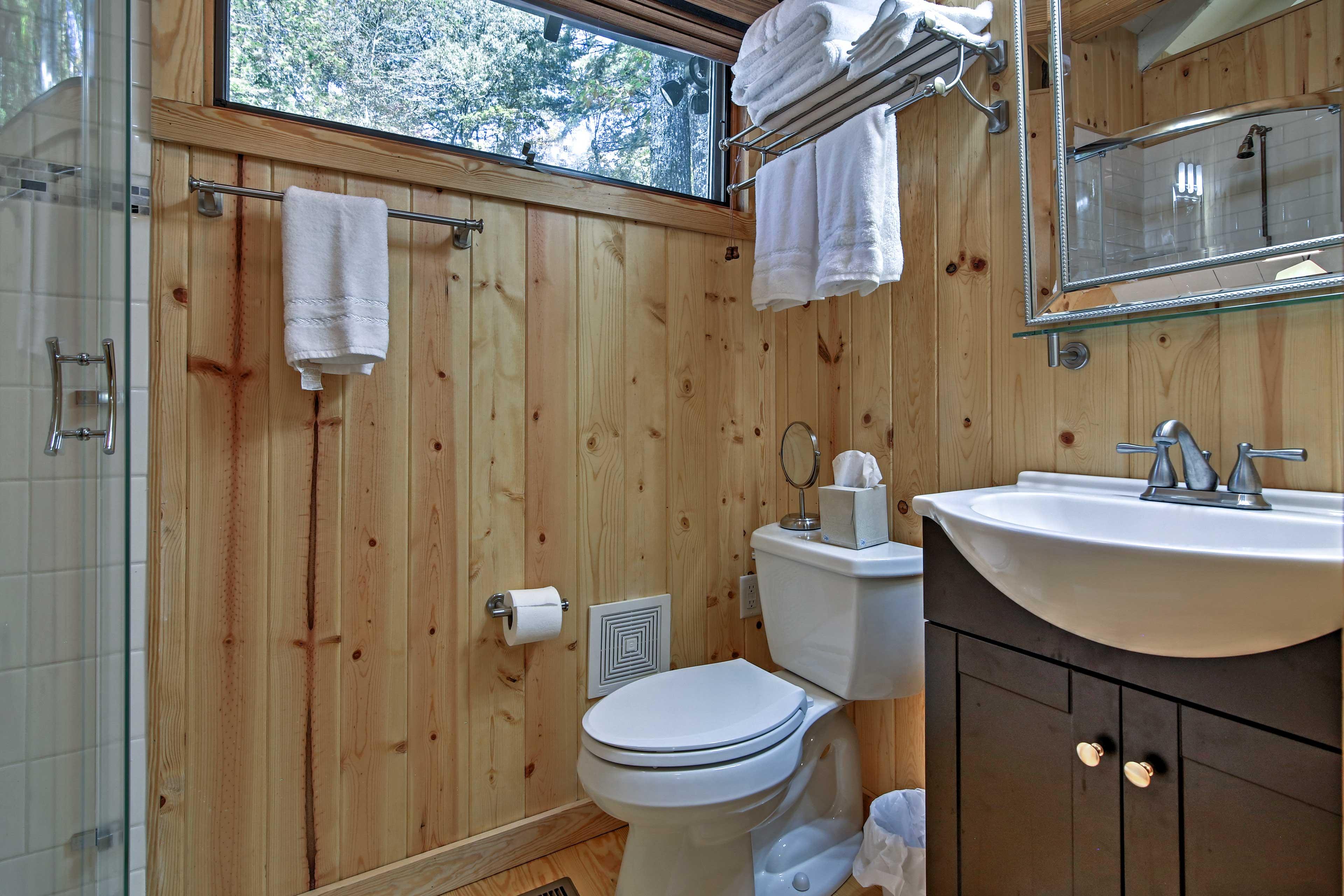 This bathroom boasts natural wood paneling.