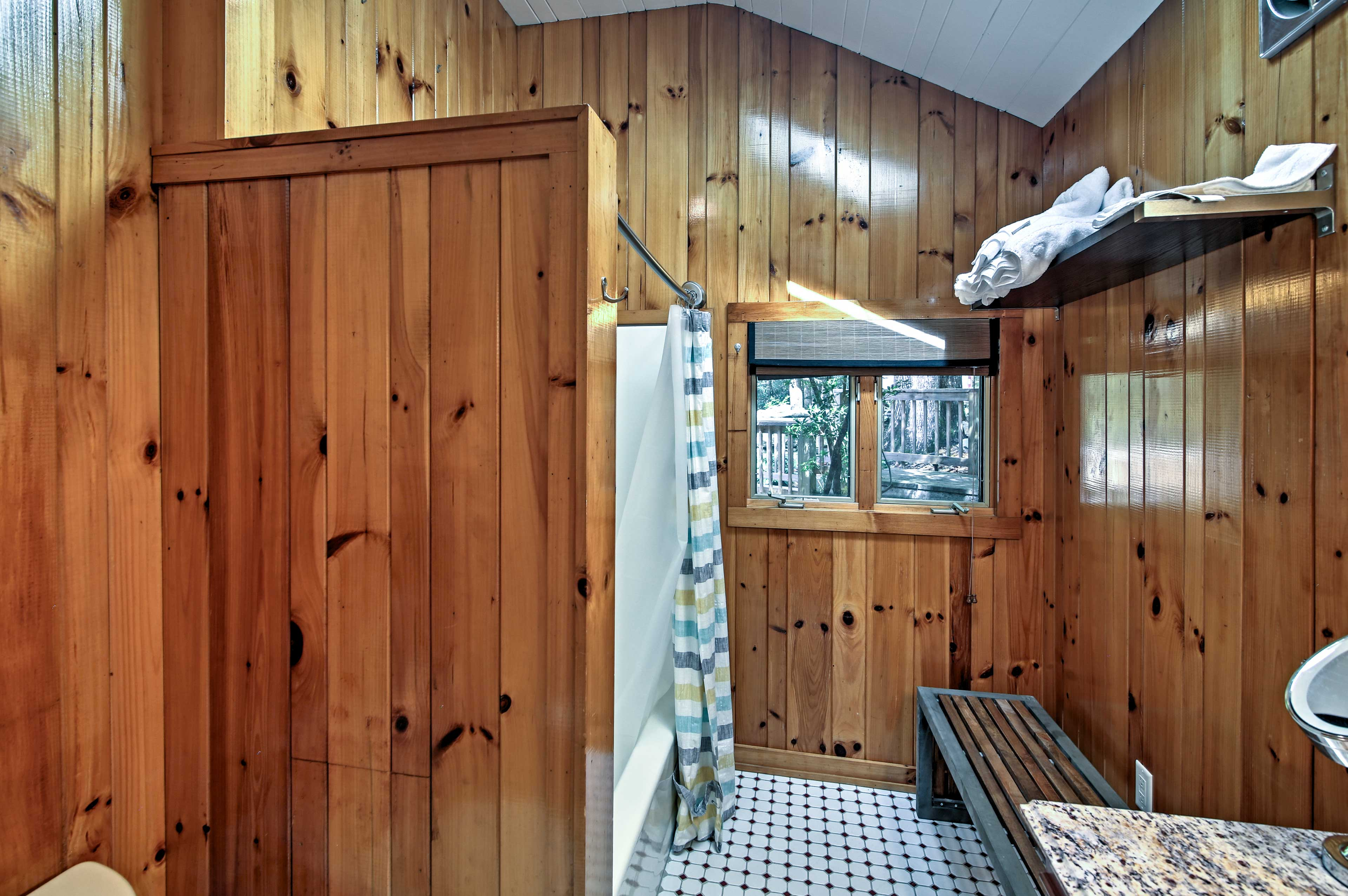 This second bathroom offers a spacious area to freshen up.