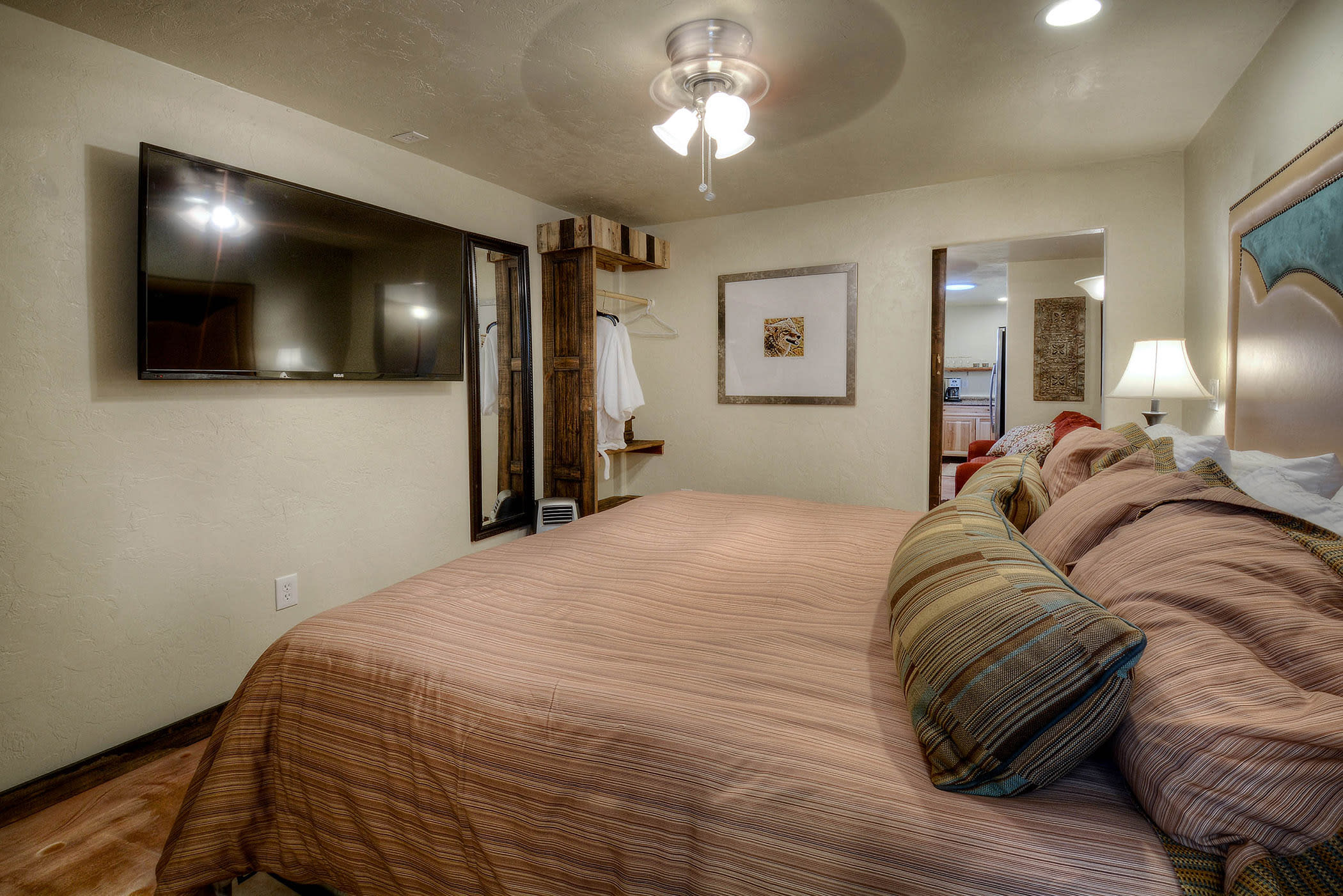 The bedroom offers a plush king bed.