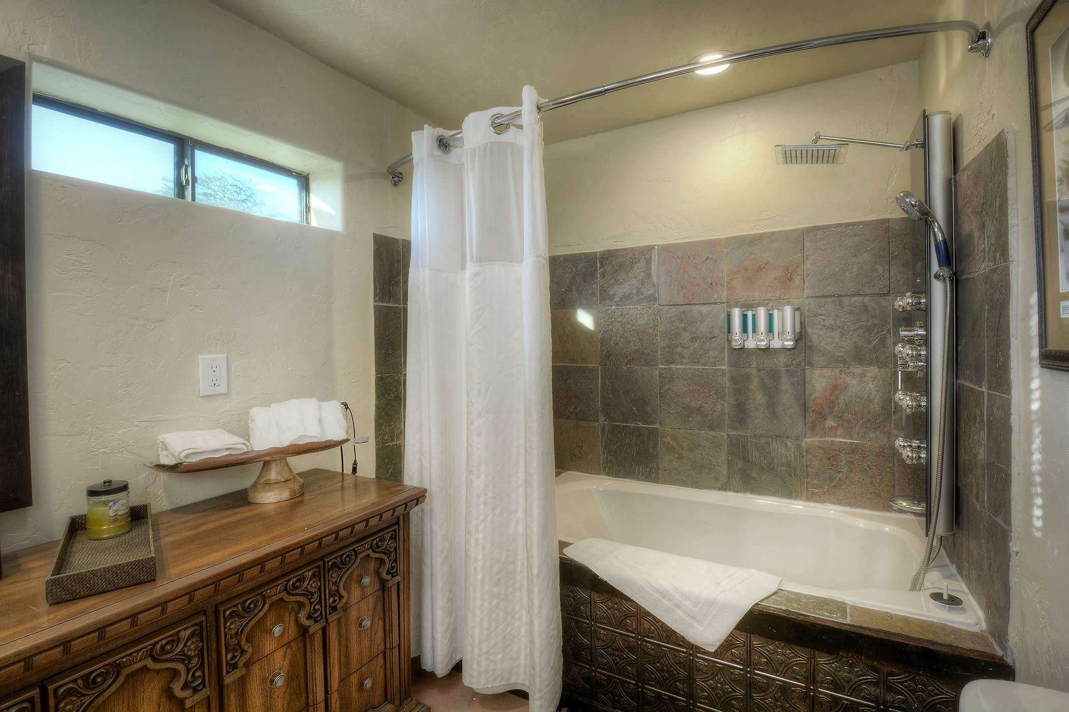 Make your way to the en-suite bathroom to rinse off in the Jacuzzi bathtub.