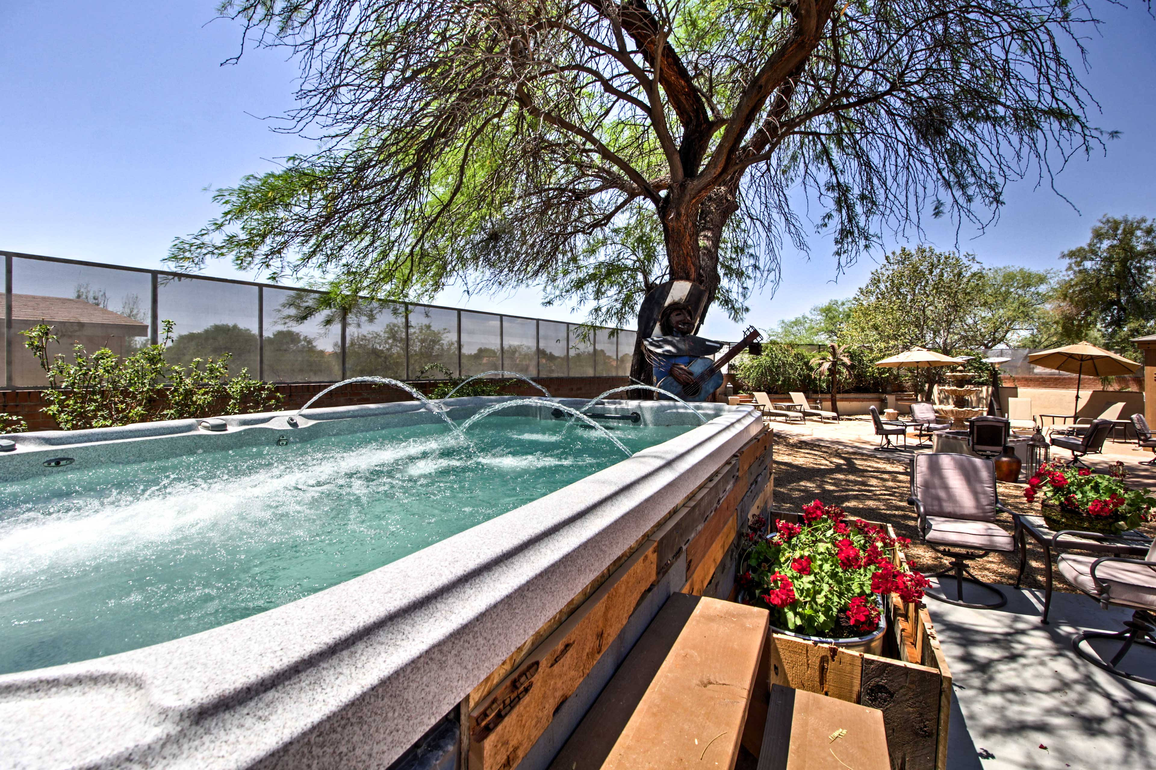 Enjoy a shared hot tub, outdoor seating areas, and a desert botanical garden!