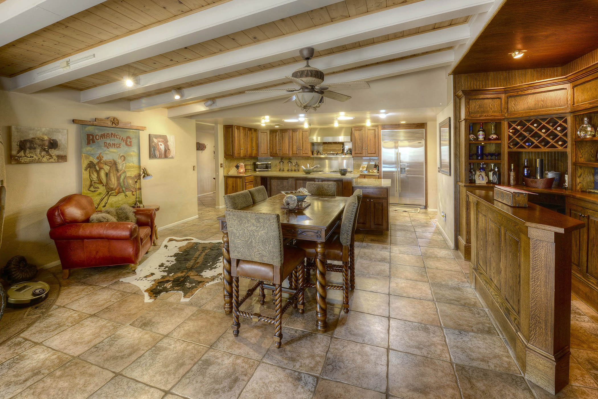 Tile flooring meets your feet in the expansive kitchen and dining area.