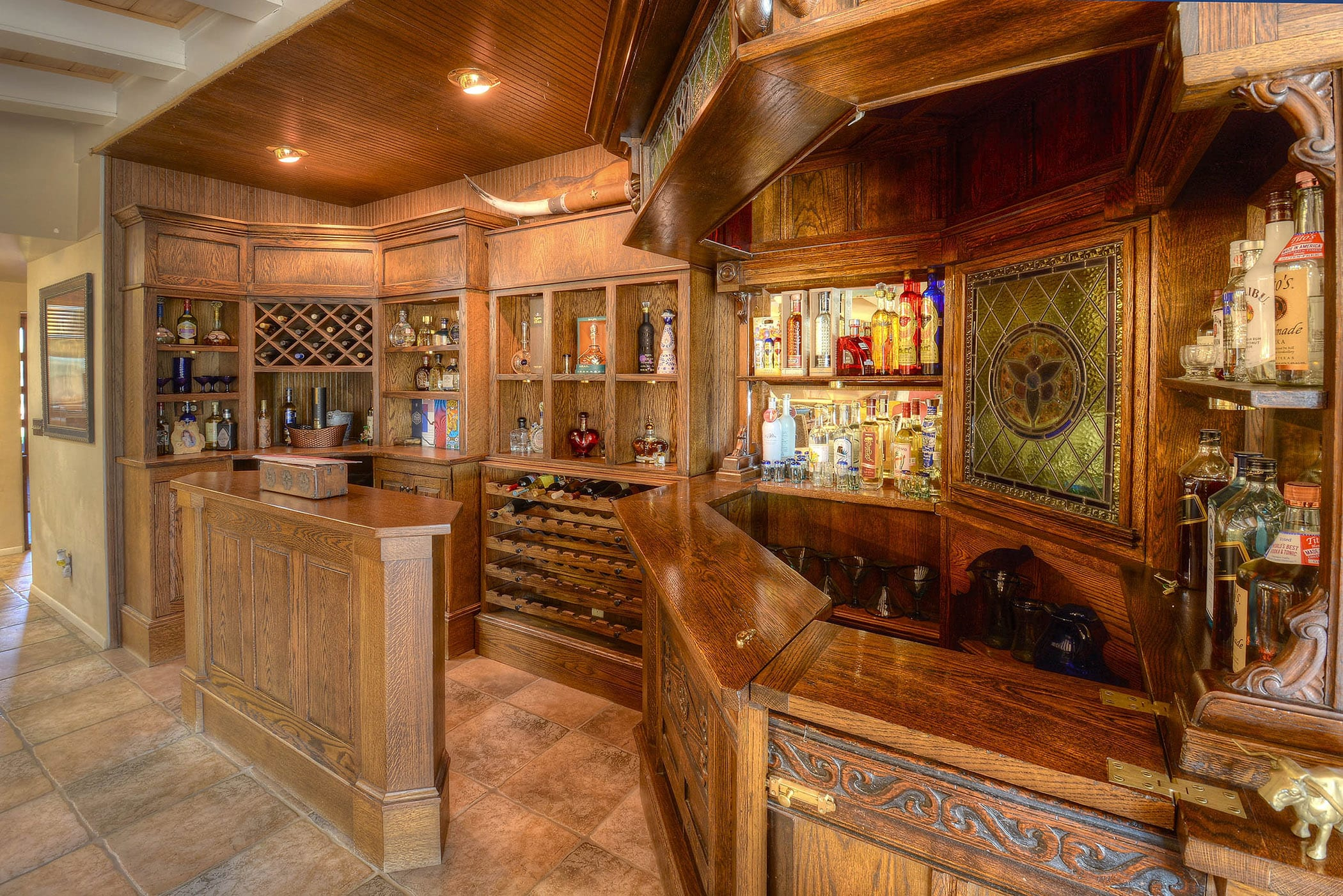 Mix your favorite drink in the full bar beside the dining area.