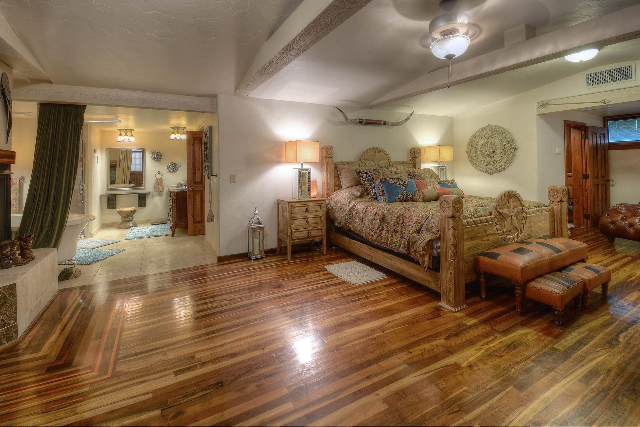 Hardwood floors meet your feet in the master bedroom.