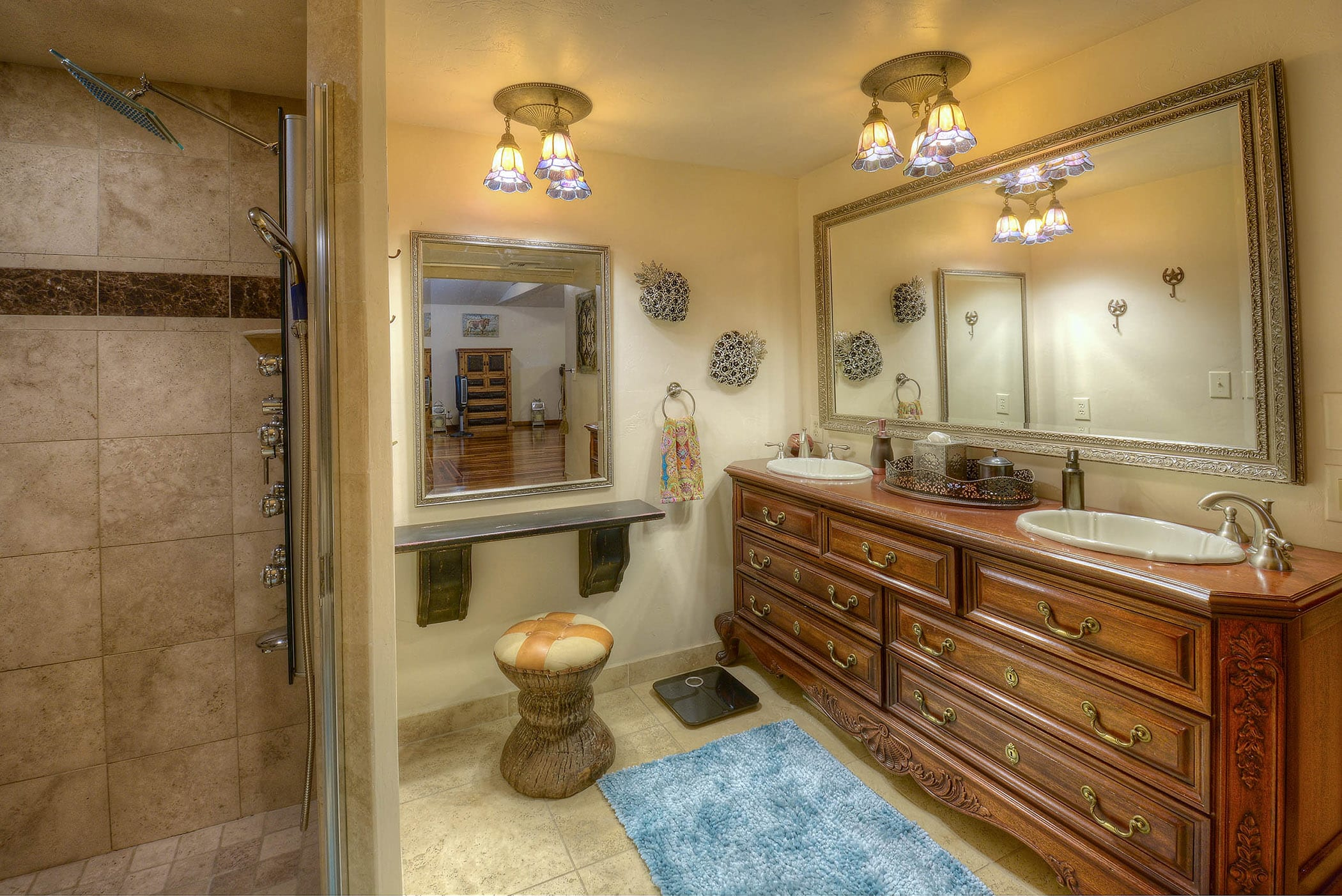 The en-suite bathroom is the perfect spot to get ready for the day.