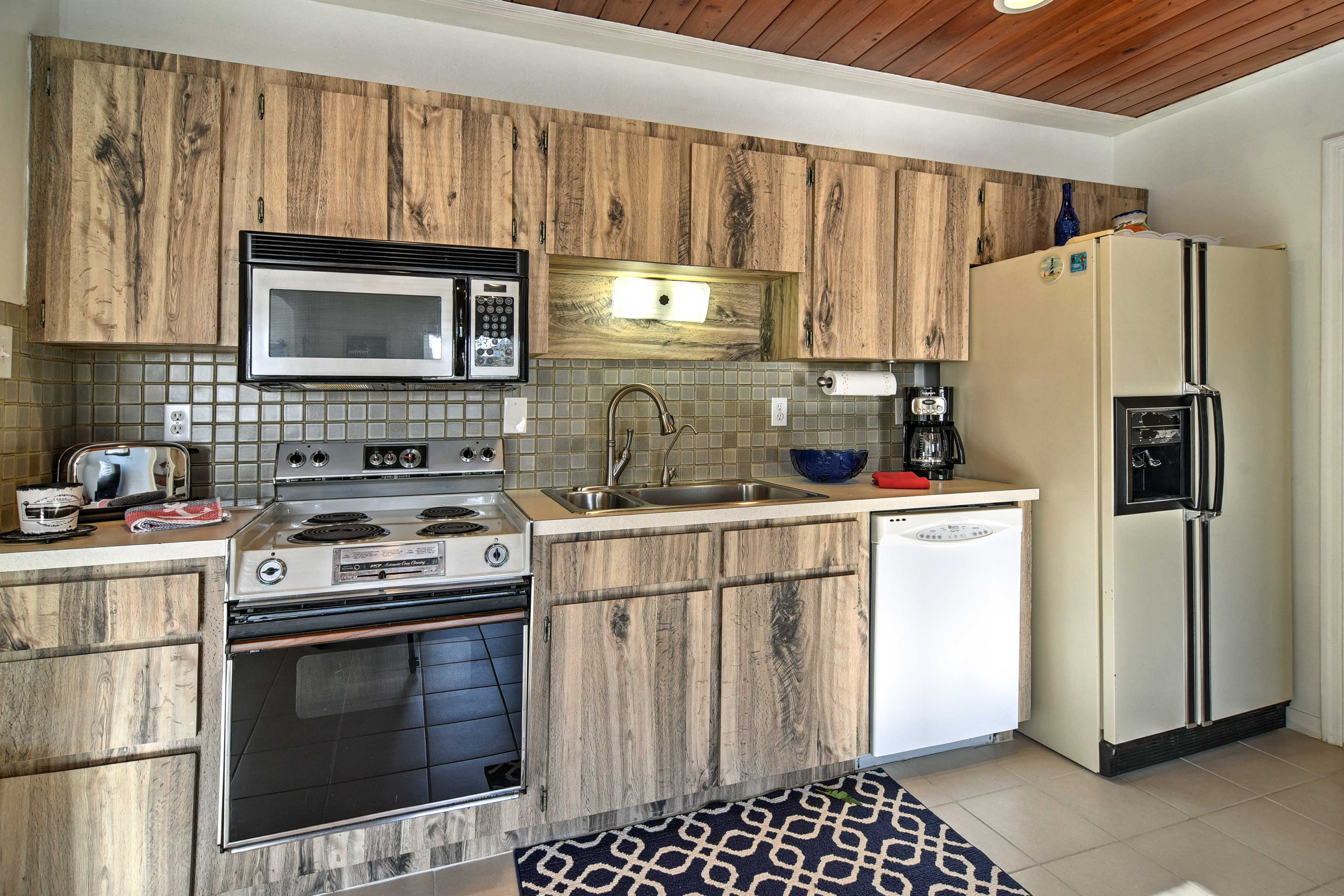 Custom cabinetry and stainless steel appliances make cooking a breeze.