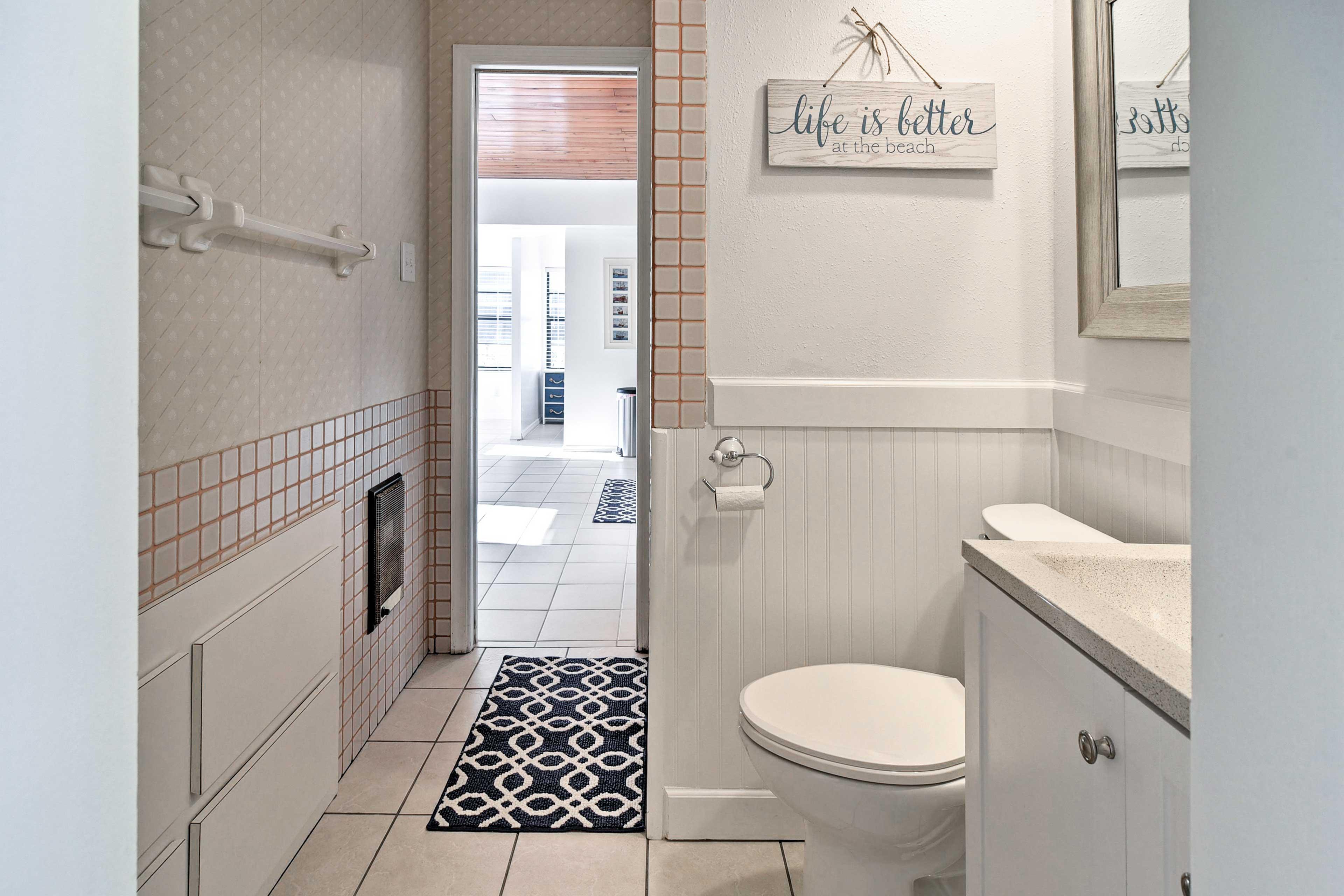 Wash off in the pristine full bathroom.