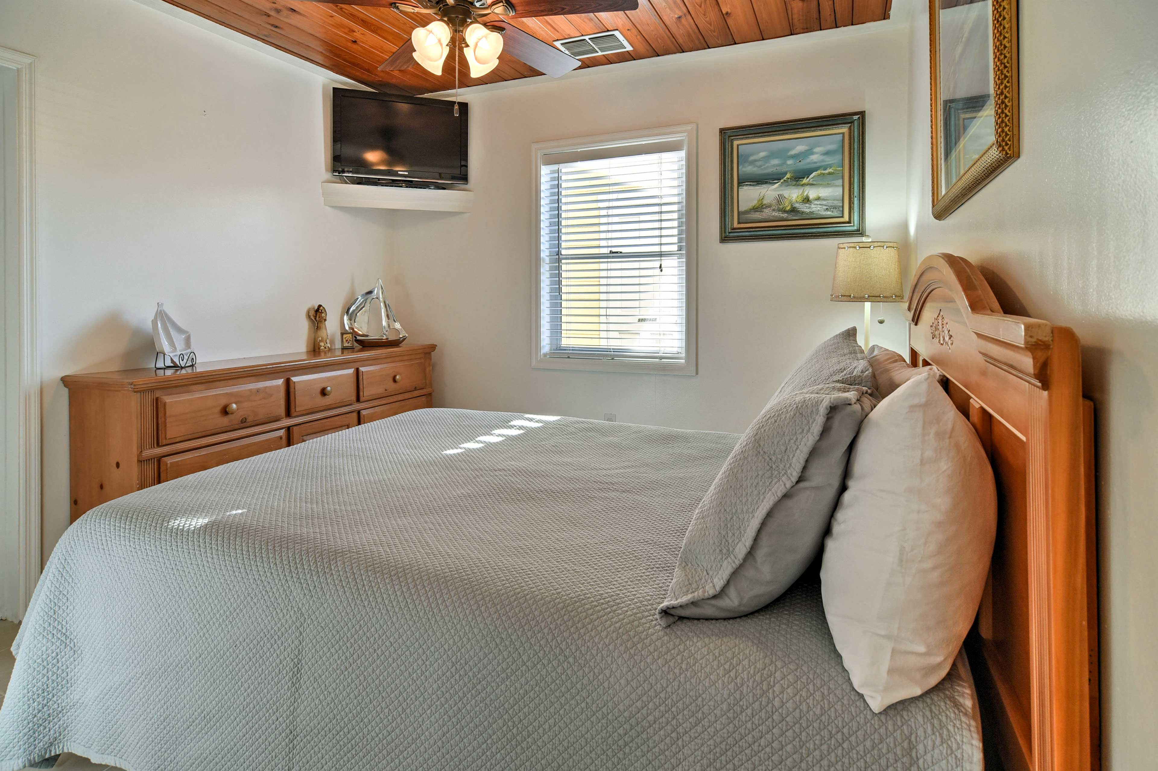 The master bedroom includes a plush queen bed.