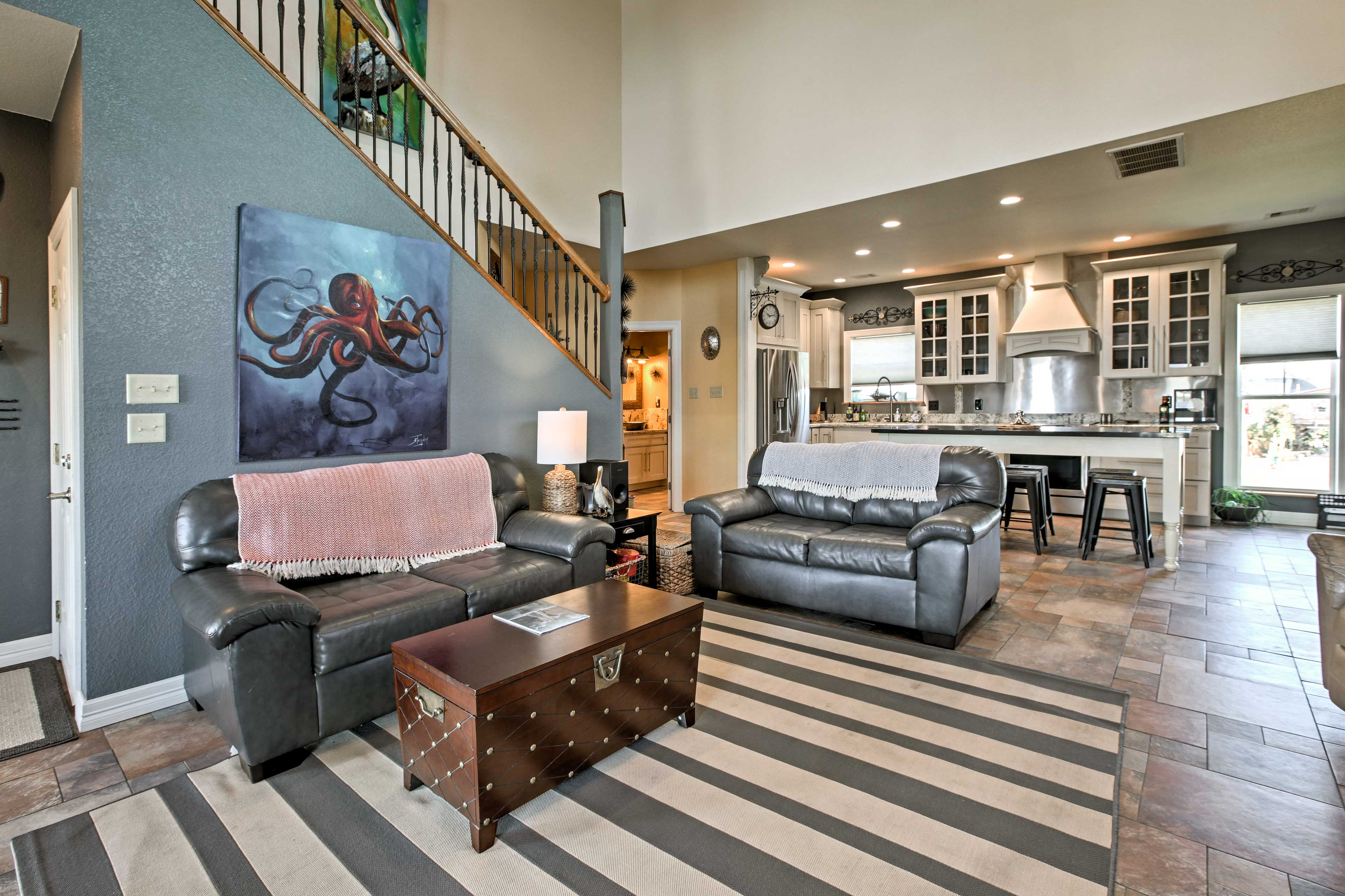 The open floor plan delivers a cohesive space with soothing earth tones.