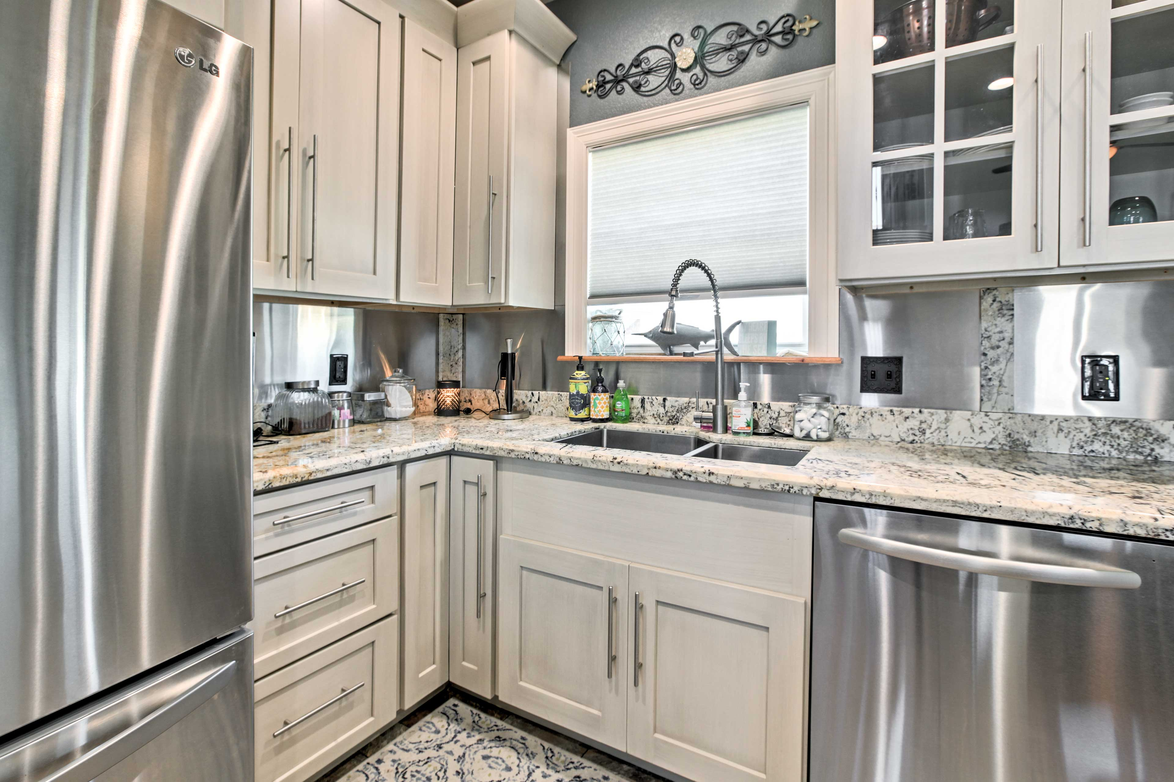 Stainless steel appliances and granite countertops set the tone for cooking.