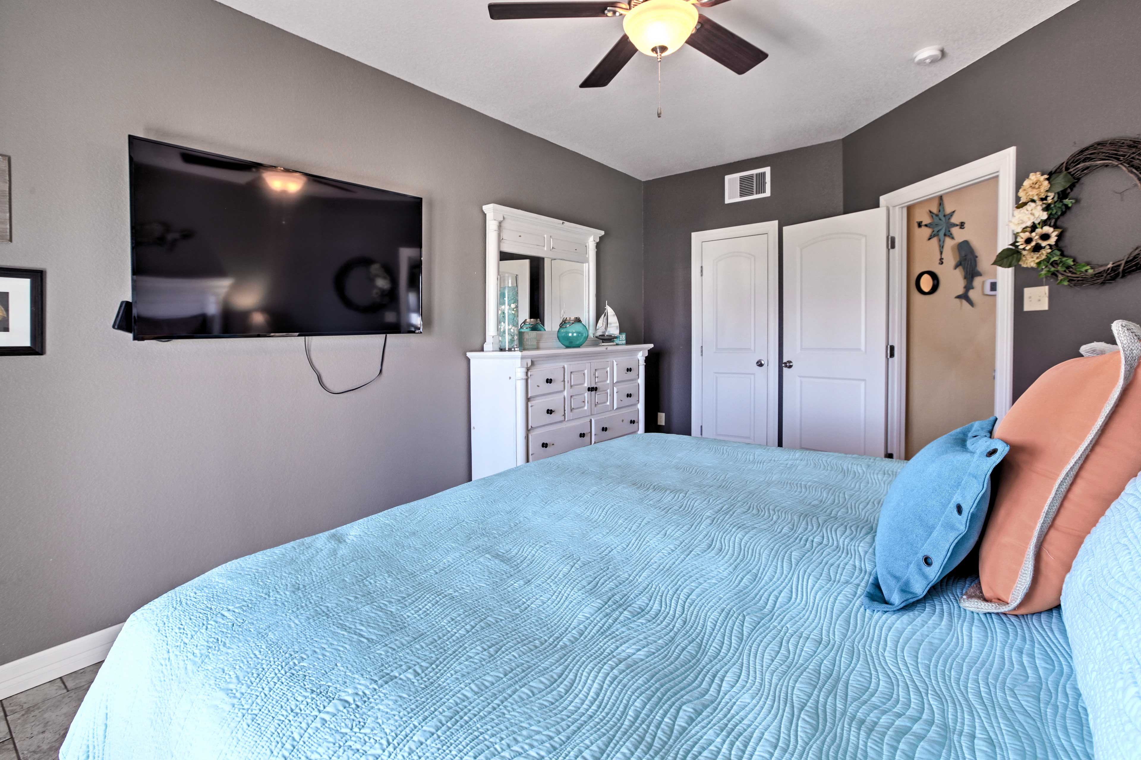 Watch a new movie from under the covers of this king bed in the master bedroom!