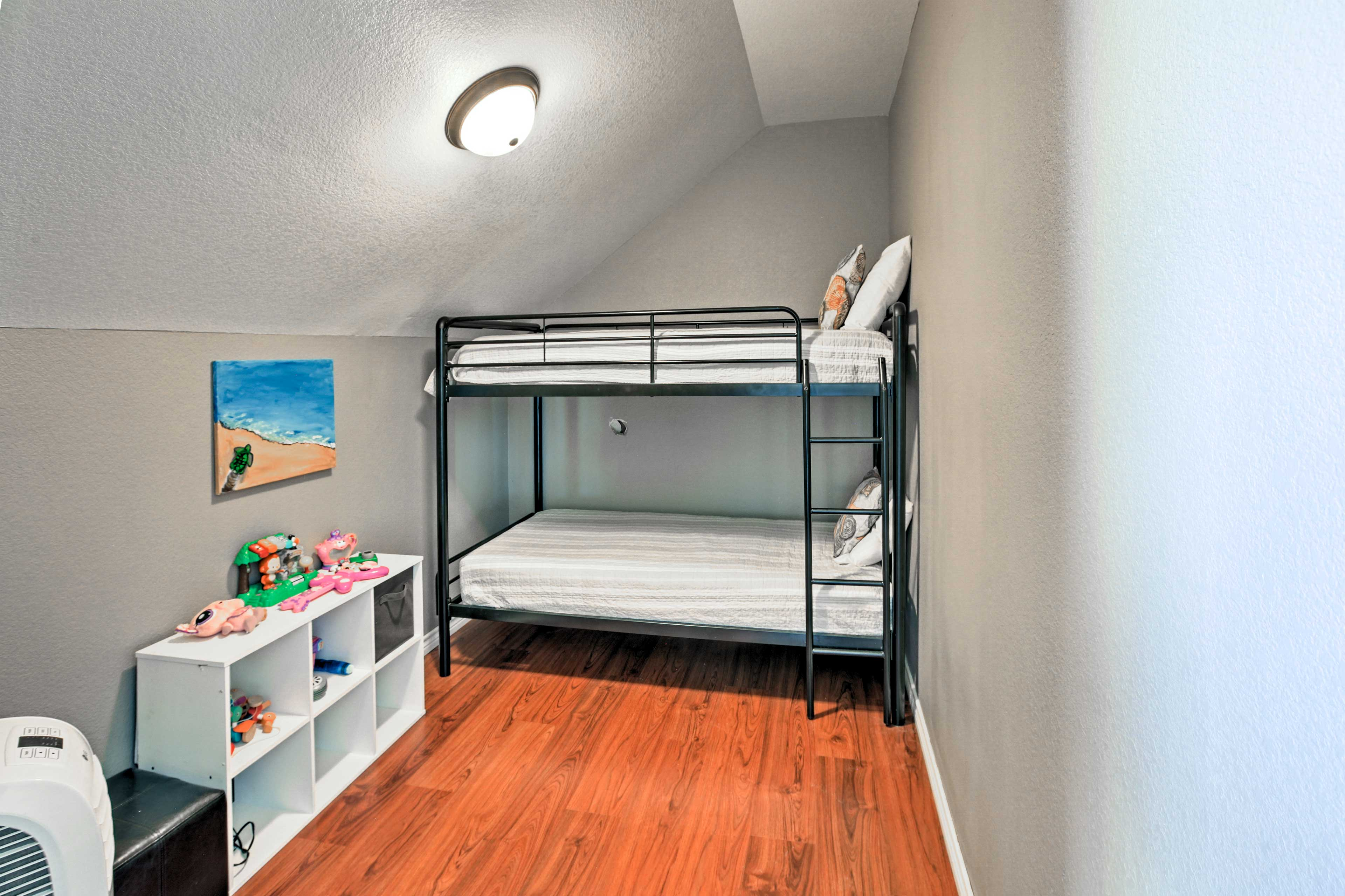 Let the kids have their own sleeping space in this second bunk room.