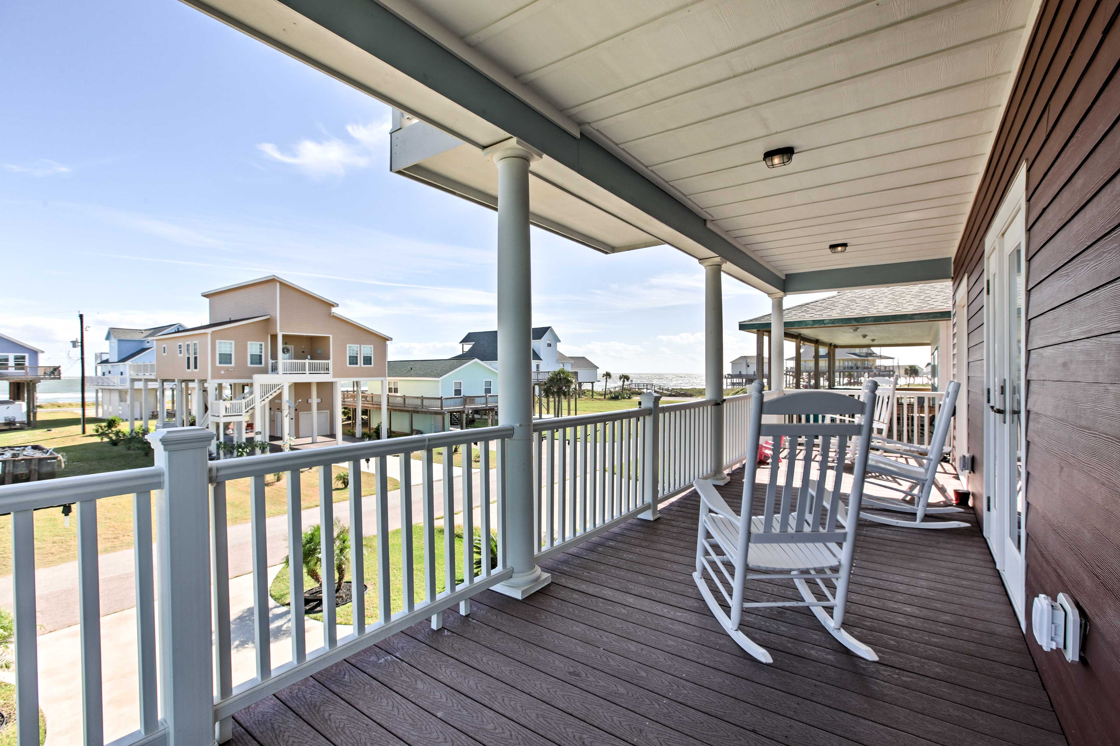 Enjoy your favorite beverage on this covered porch.