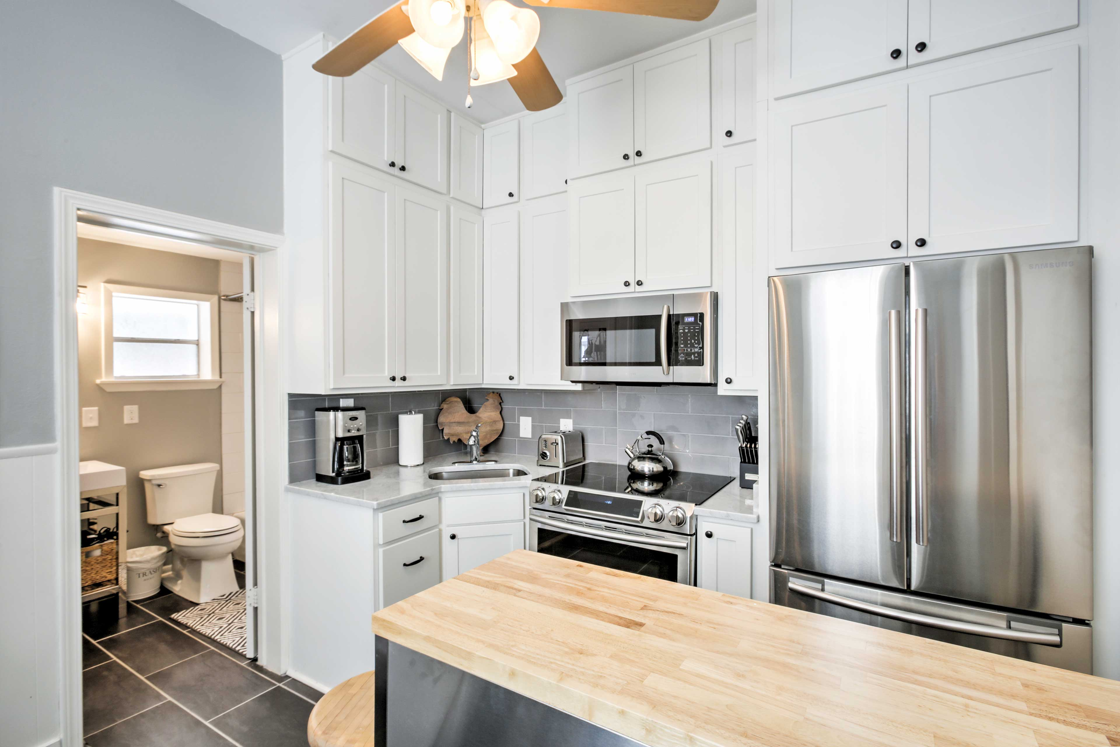 Utilize the stainless steel appliances in the kitchen for nights spent dining in.