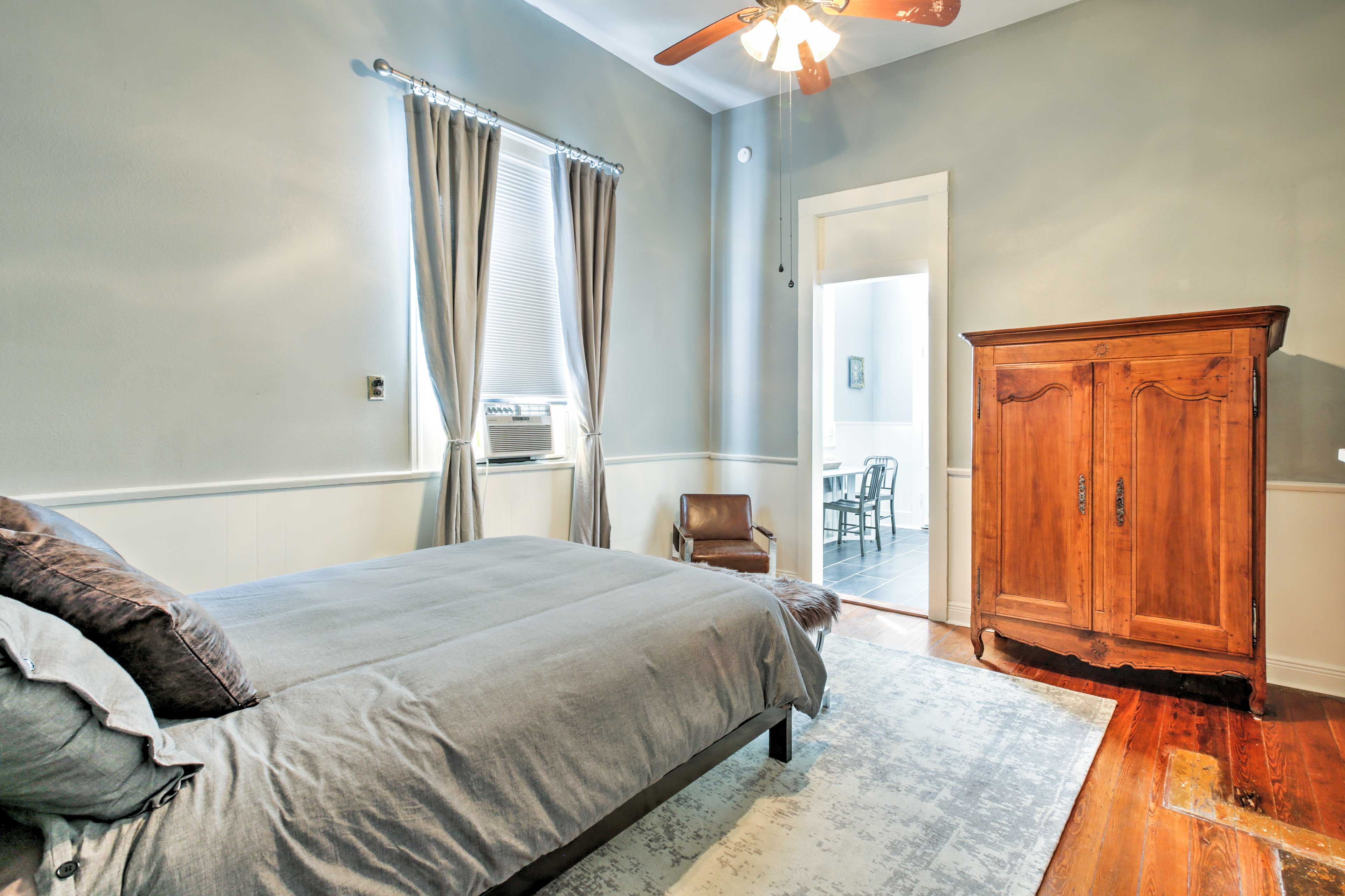 The master bedroom features a dresser and armoire to provide plenty of storage space.
