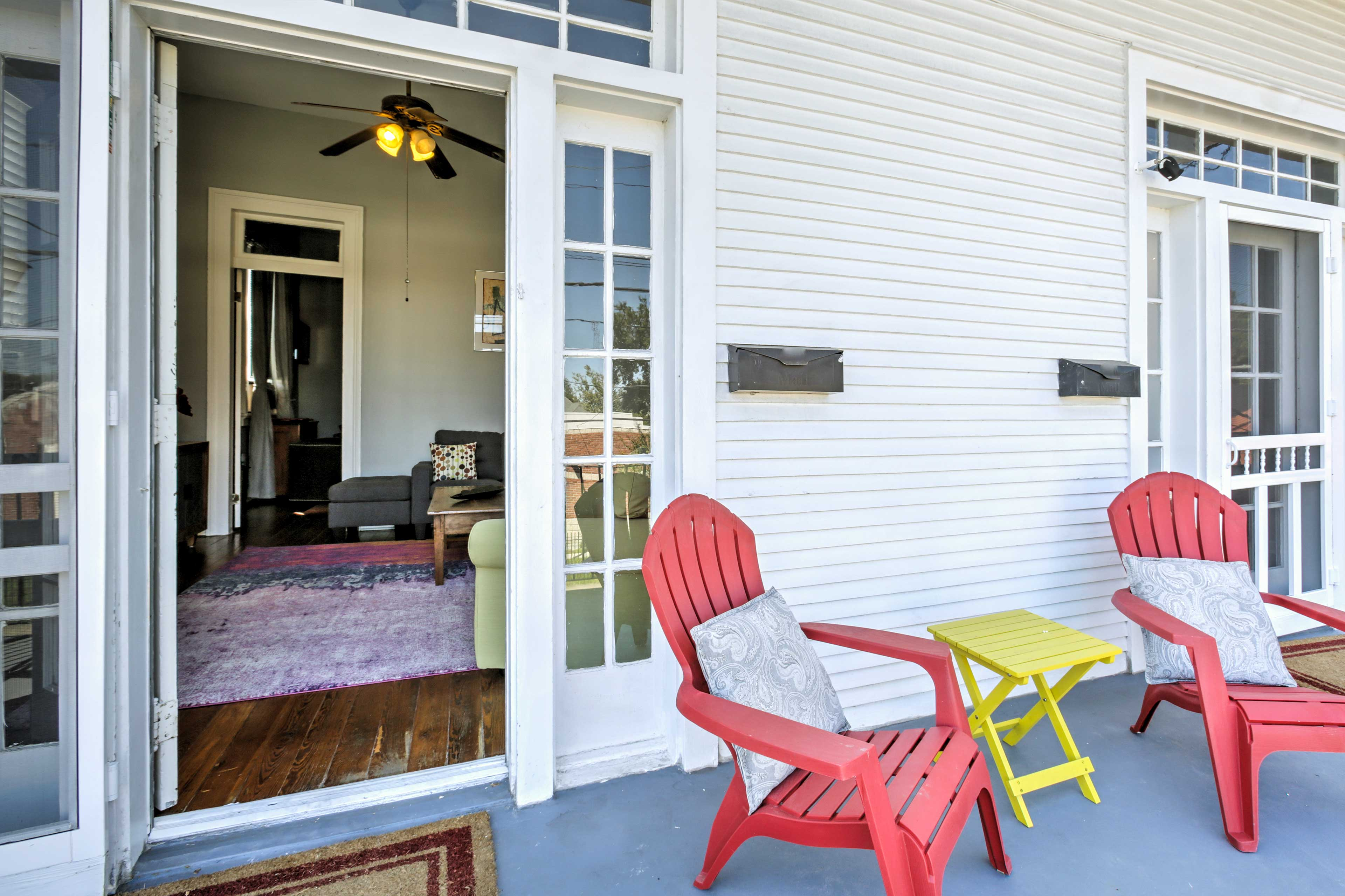 The French doors open out onto a large private front balcony.