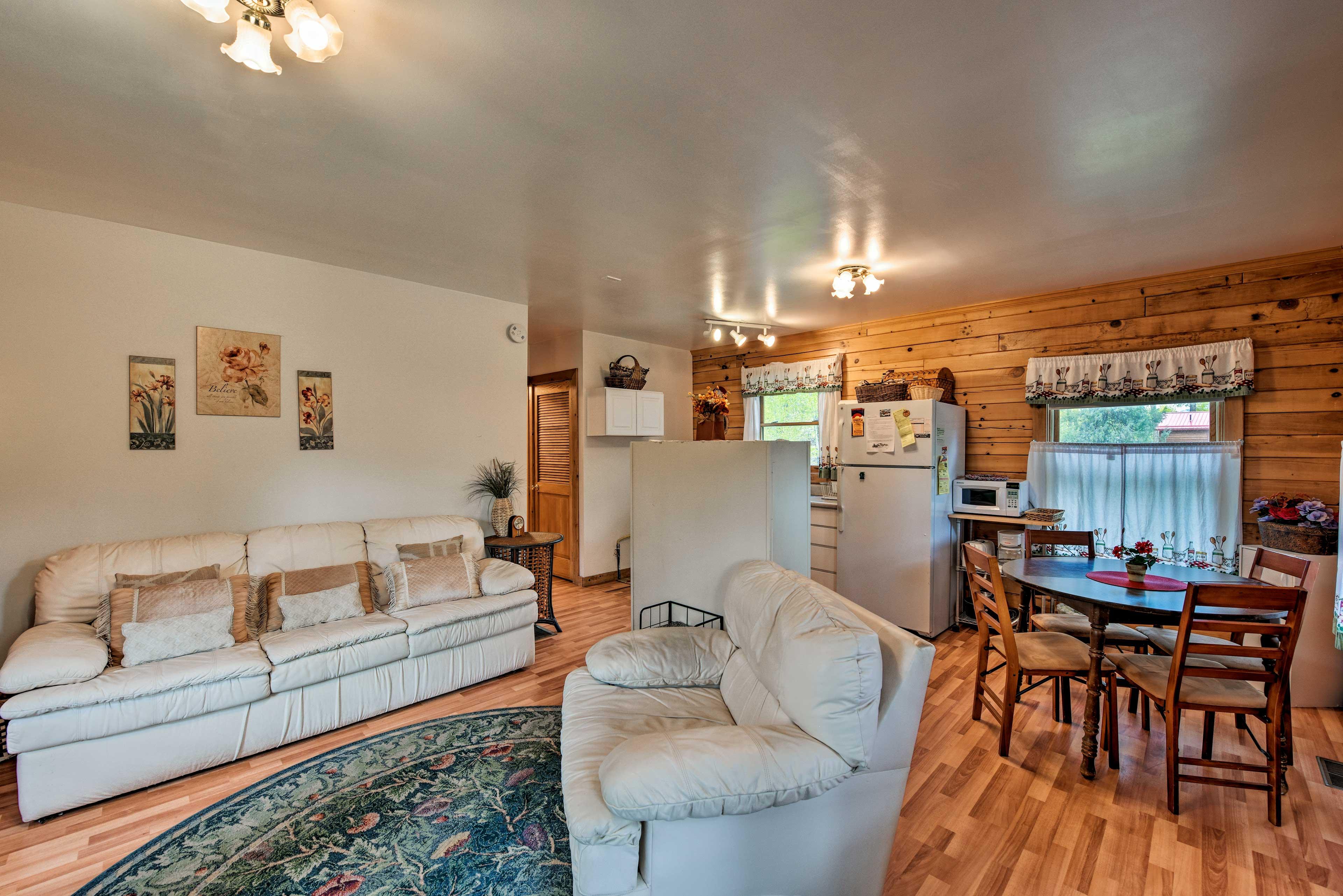 The cabin boasts hardwood floors and rustic decor.