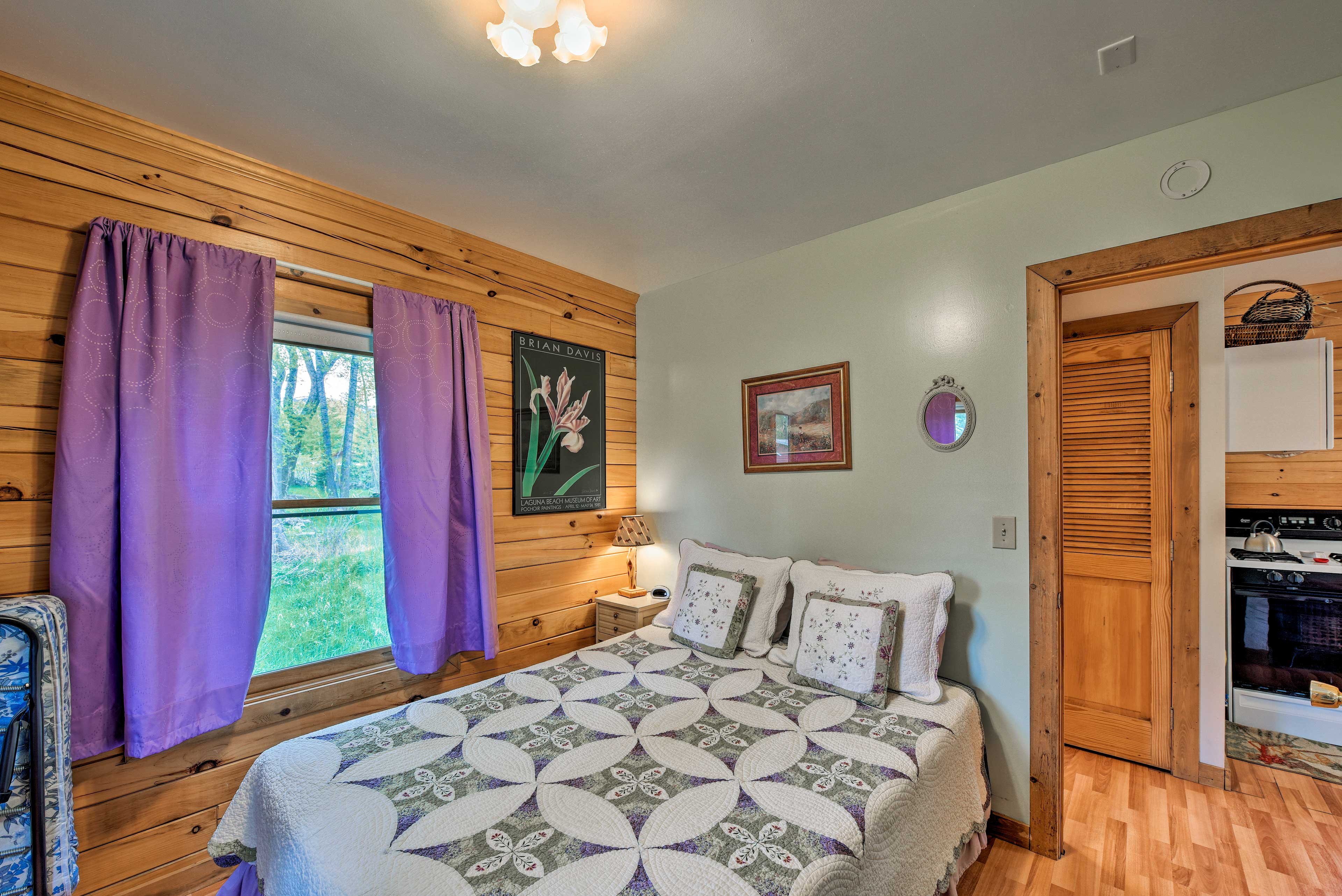 The bedroom boasts a full-sized bed.