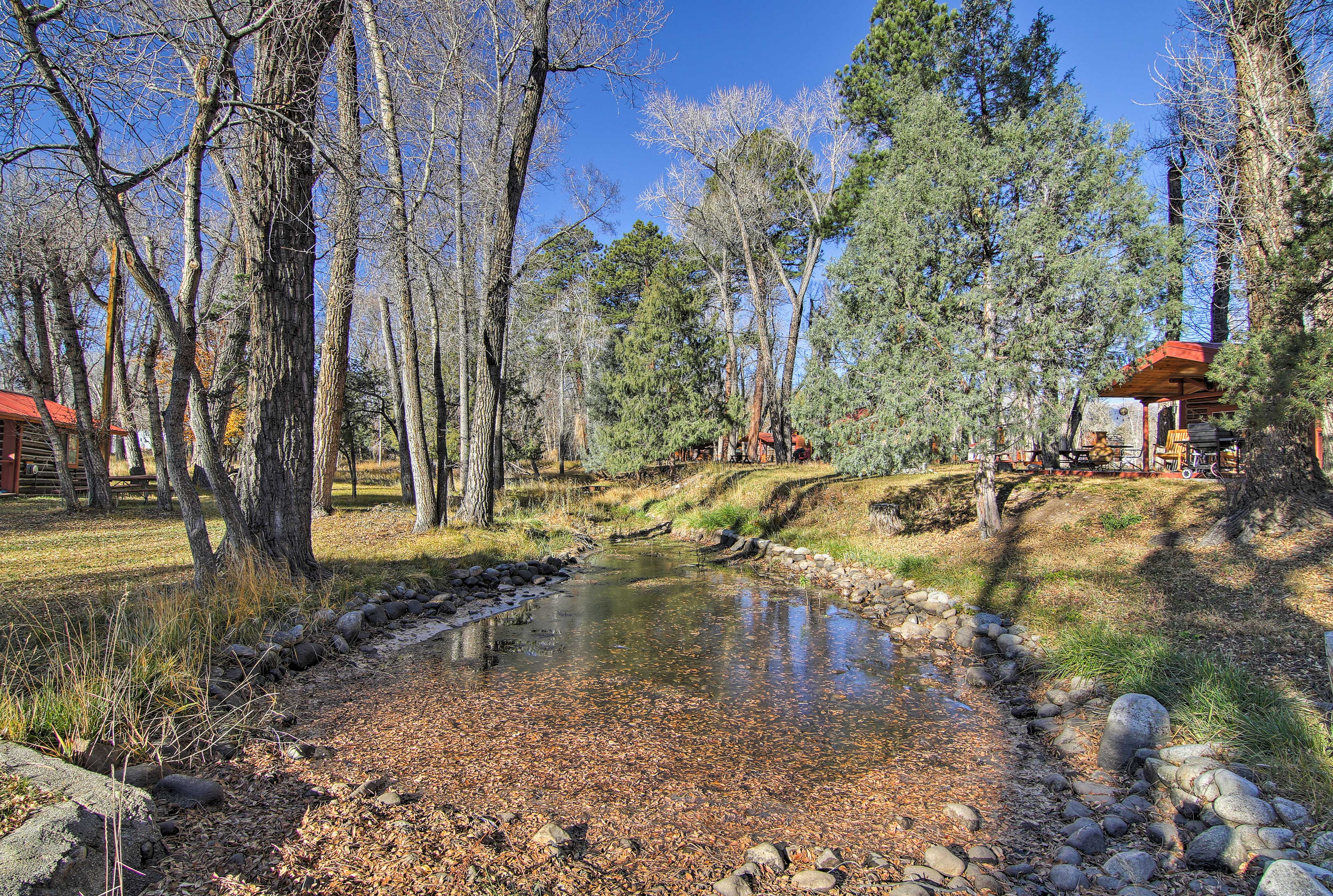 A babbling brook runs through the property.