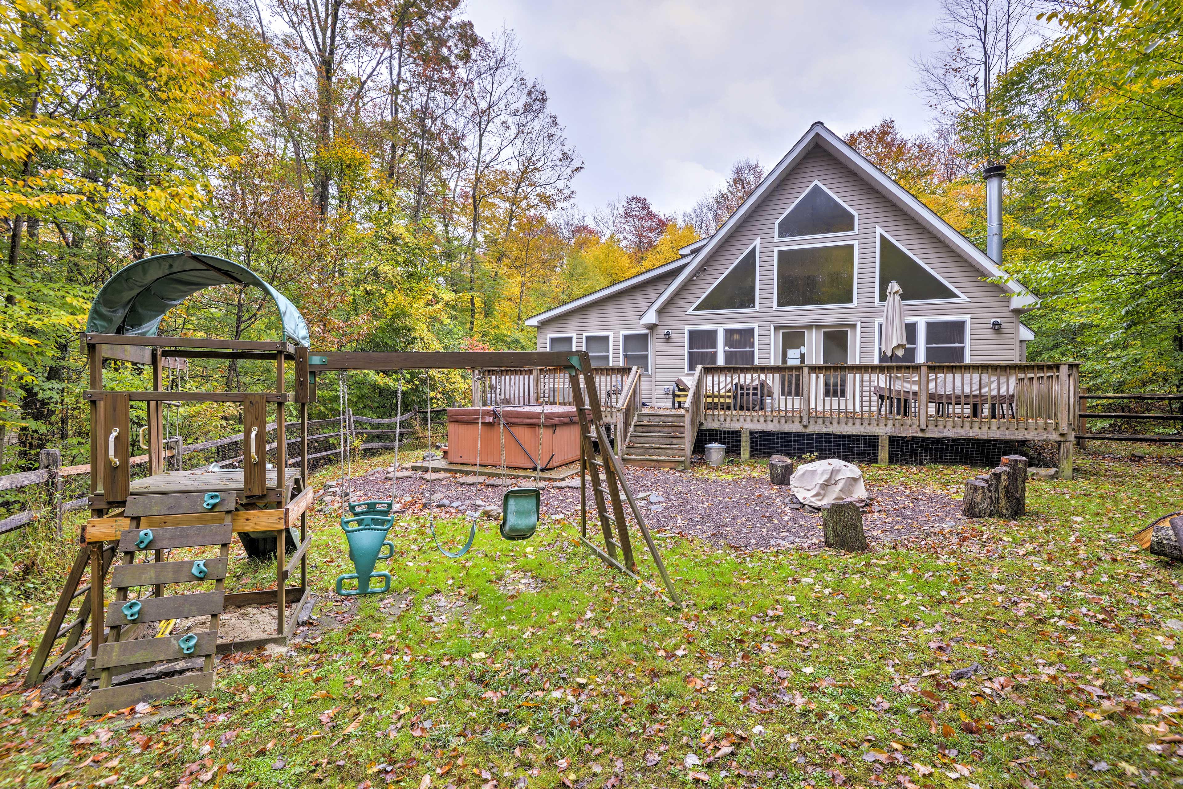 A serene mountain retreat awaits at this vacation rental cabin in Pocono Lake.