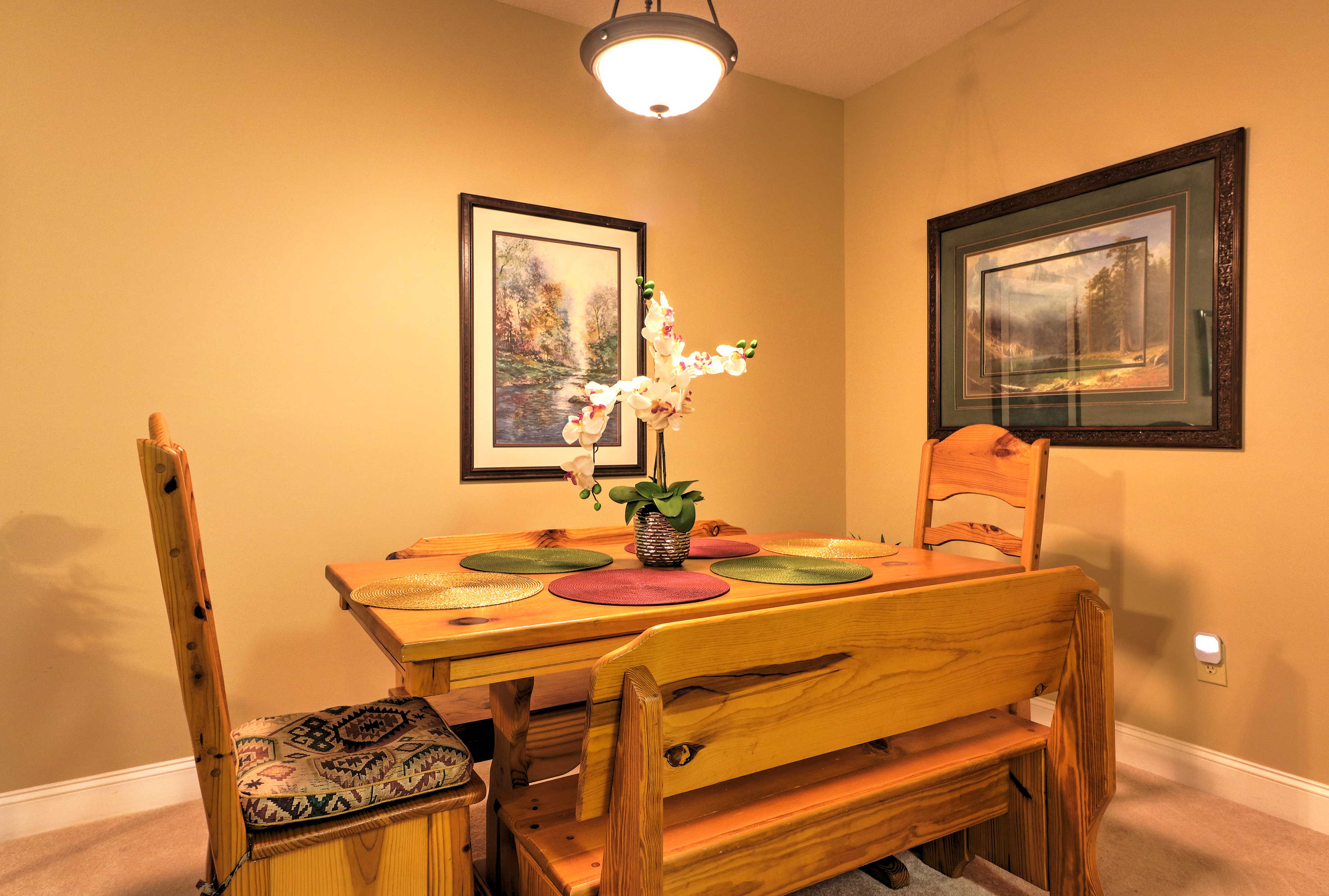 Enjoy a delicious family dinner at the rustic dining table with seating for 6.
