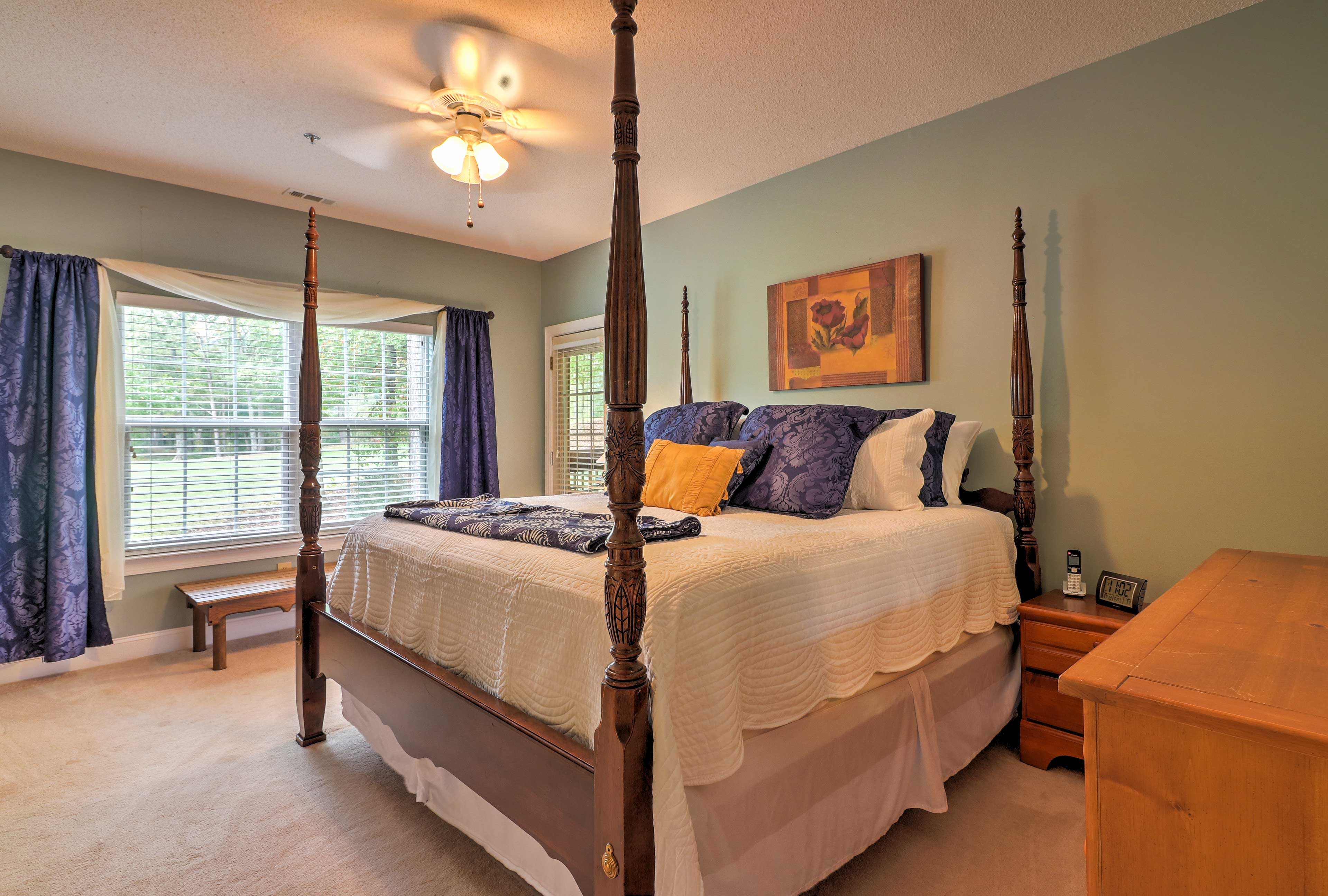 Climb under the covers of the king-sized bed in the master bedroom.