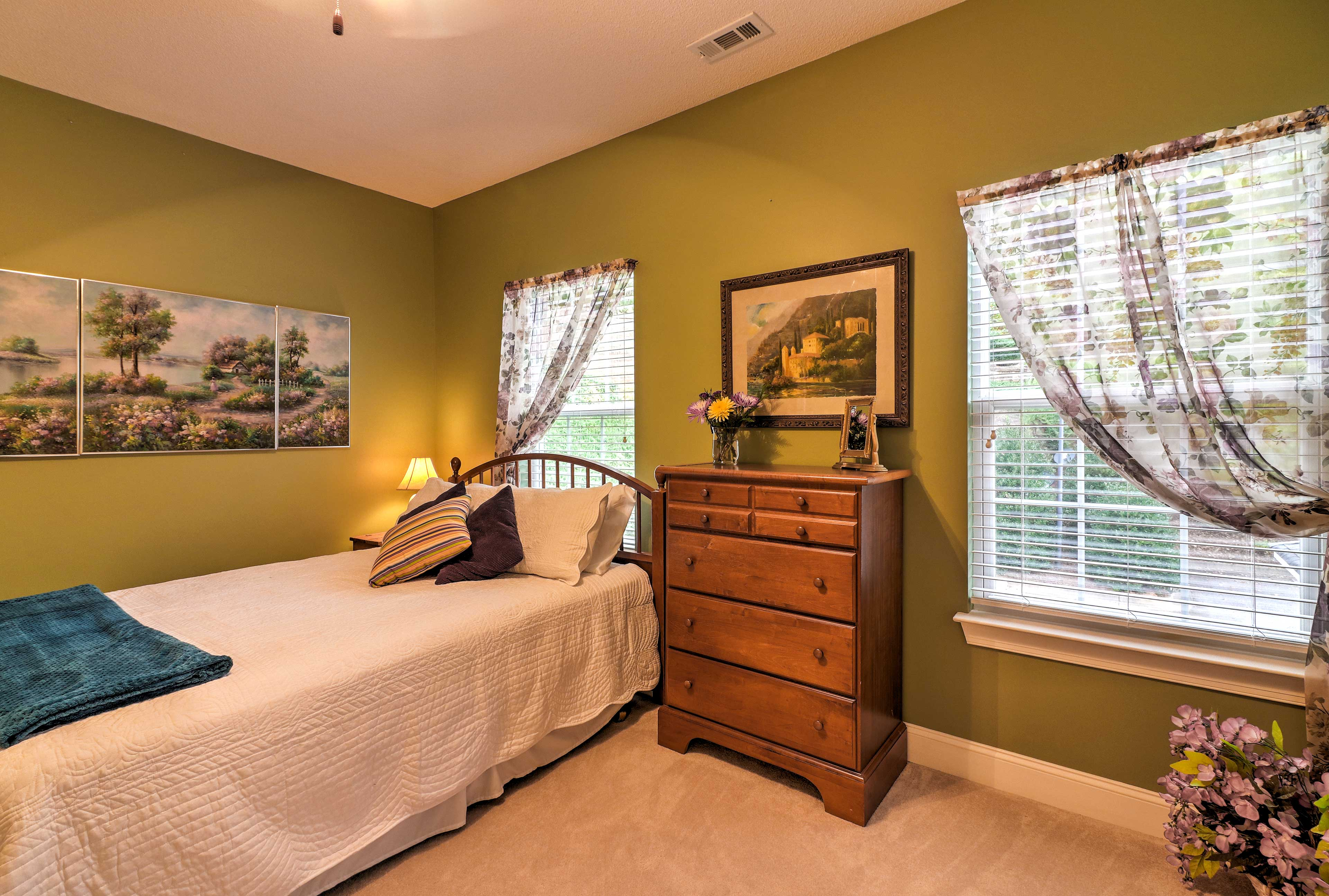 The second bedroom features a soft queen-sized bed.