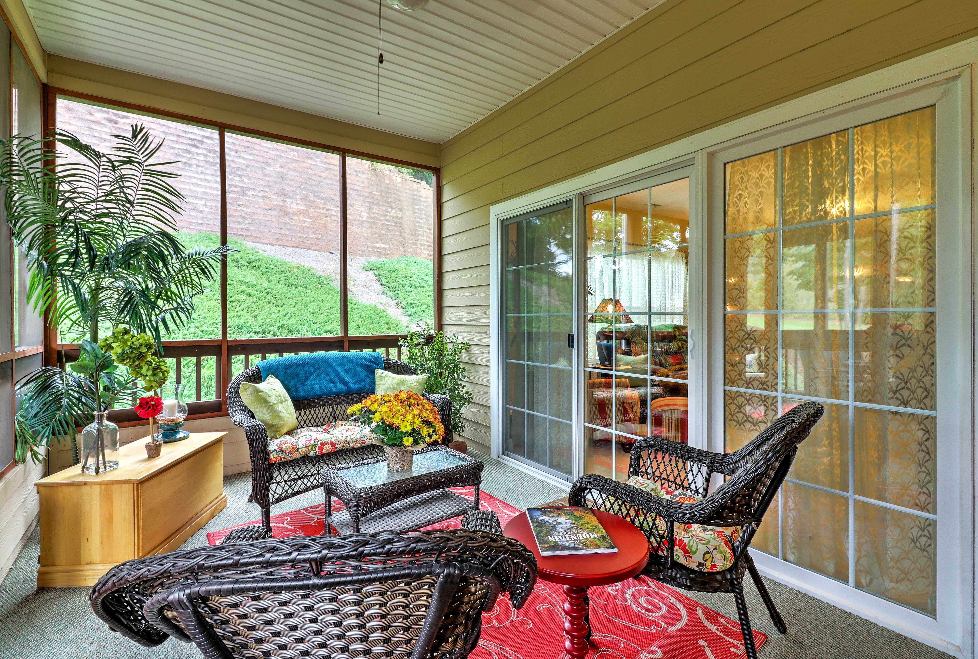 Sip your morning coffee and make plans for the day in the screened-in sunroom.