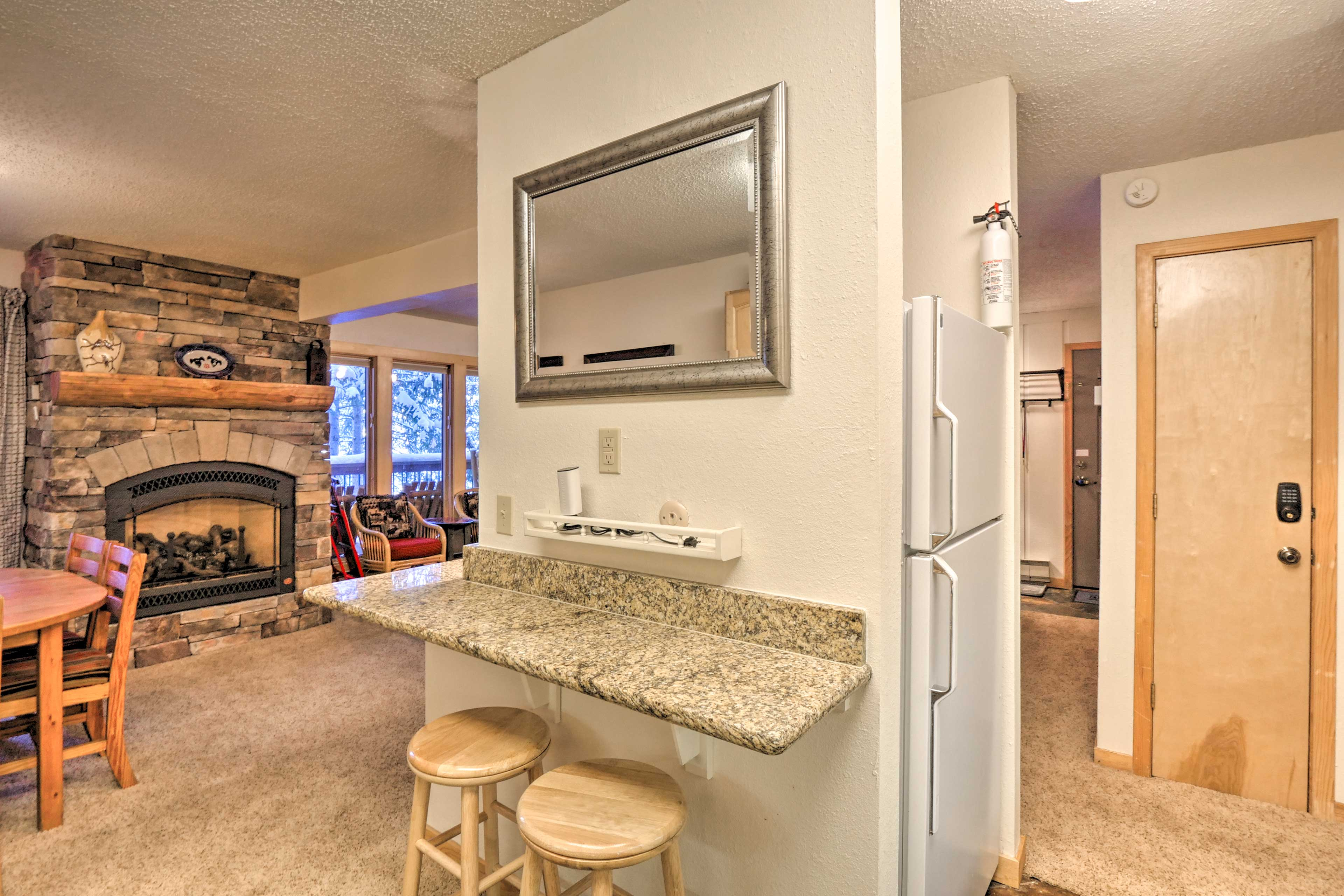 The fireplace creates a cozy ambiance in the unit.
