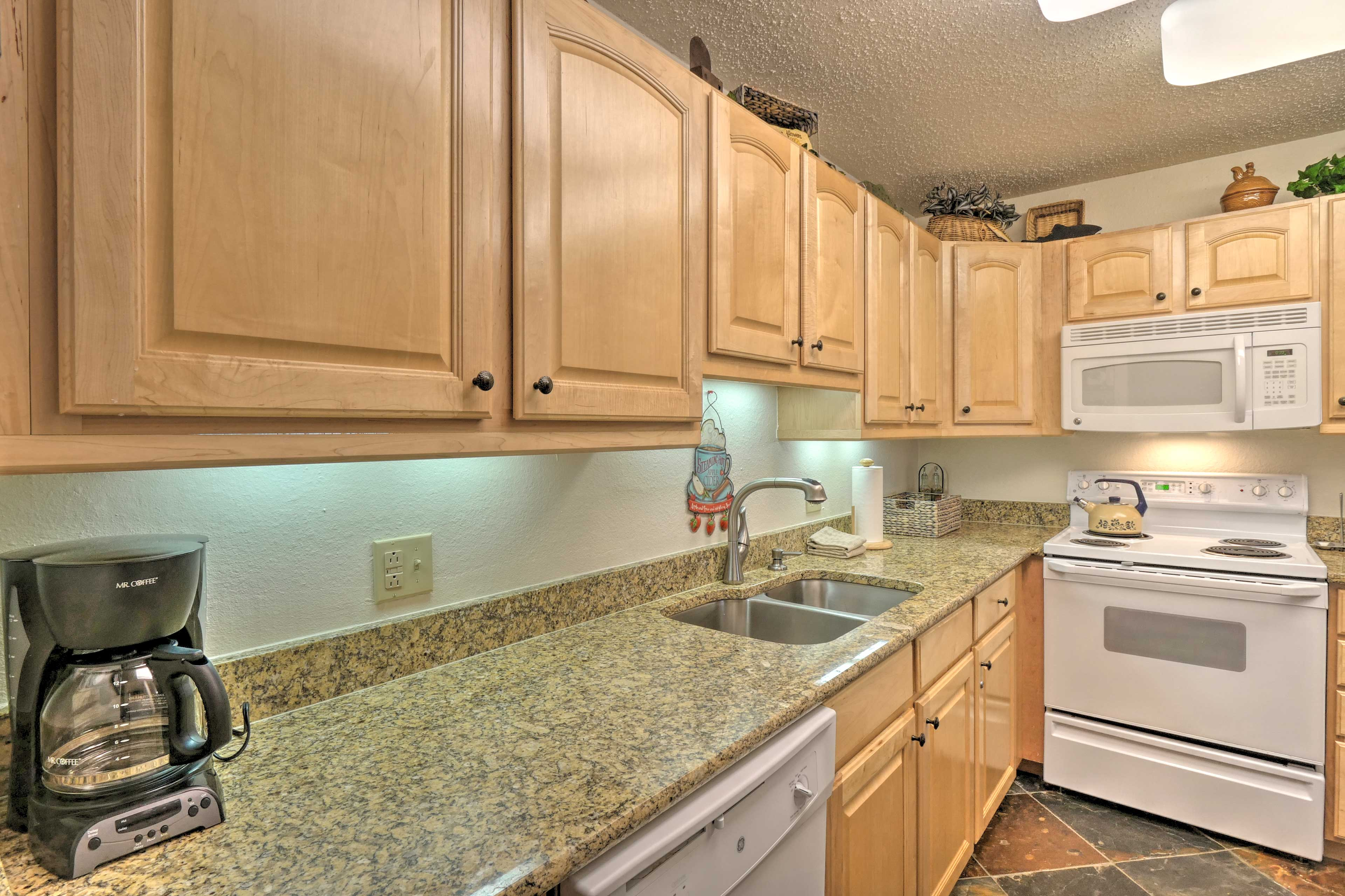 The fully equipped kitchen has options for drip coffee or tea.