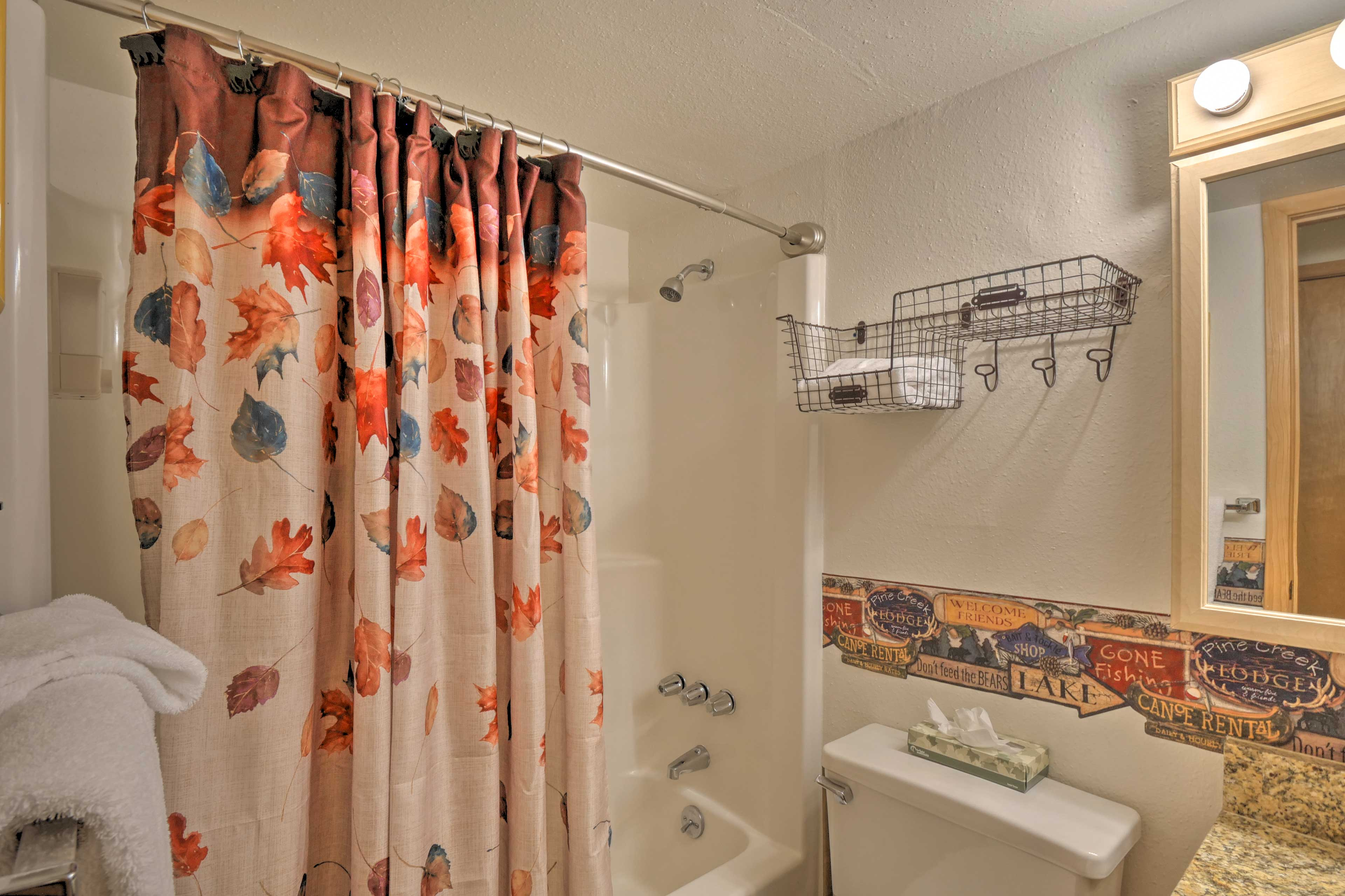 The first full bathroom has a shower/tub combo.