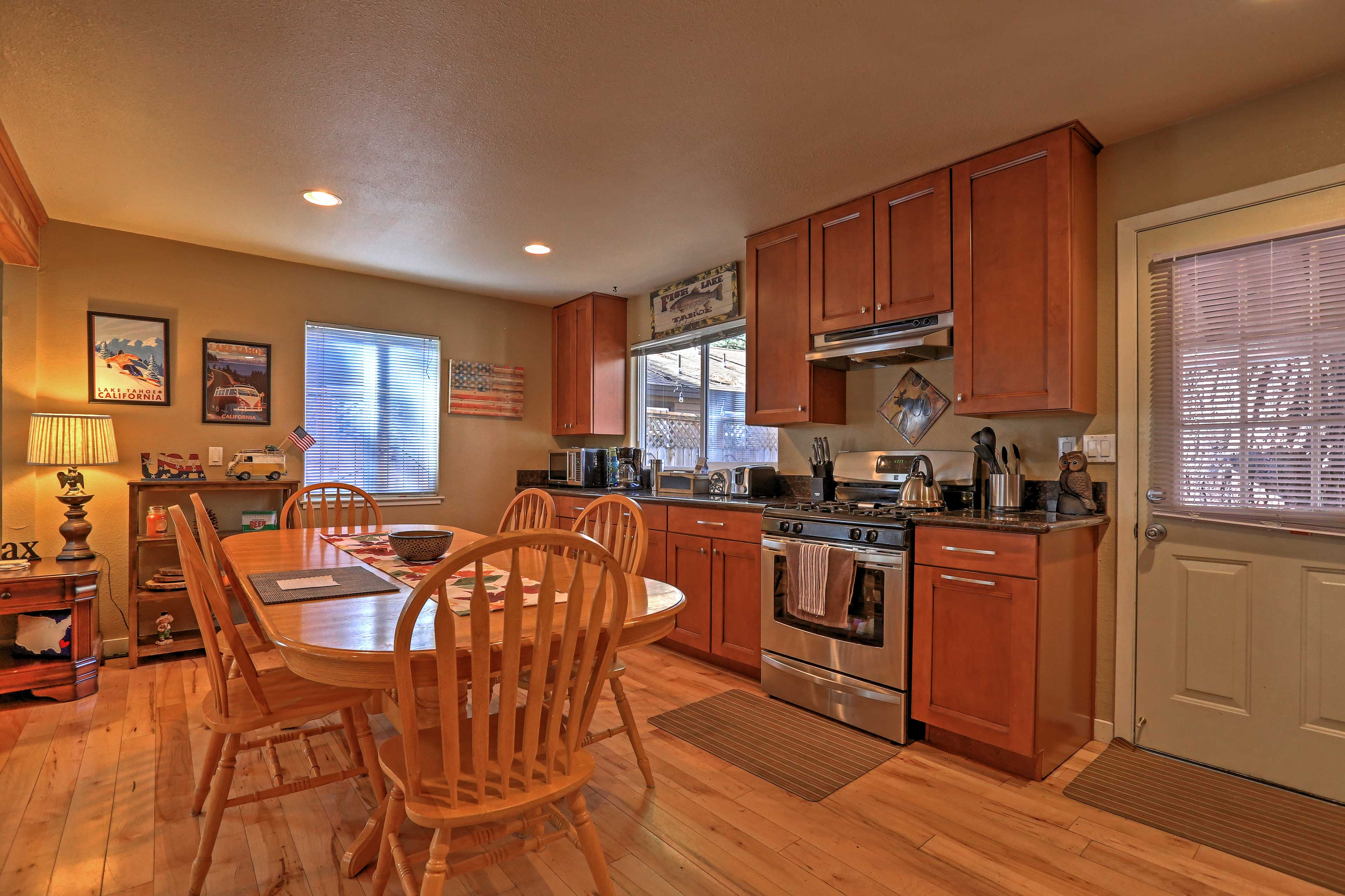 Natural wood elements, stainless steal appliances, and granite counters highlight the fully equipped kitchen.