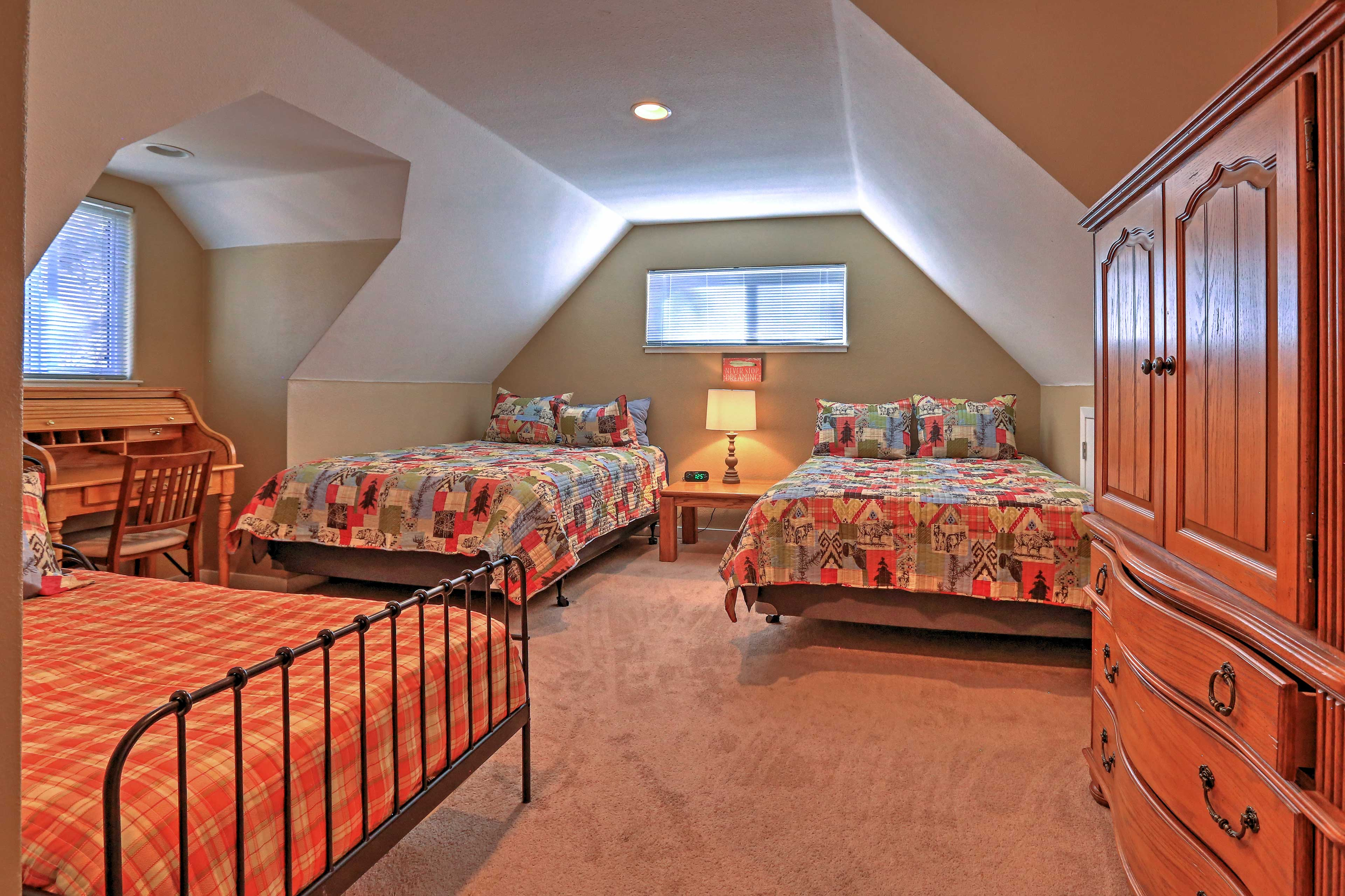 This third bedroom boasts 2 queen beds and a twin bed.