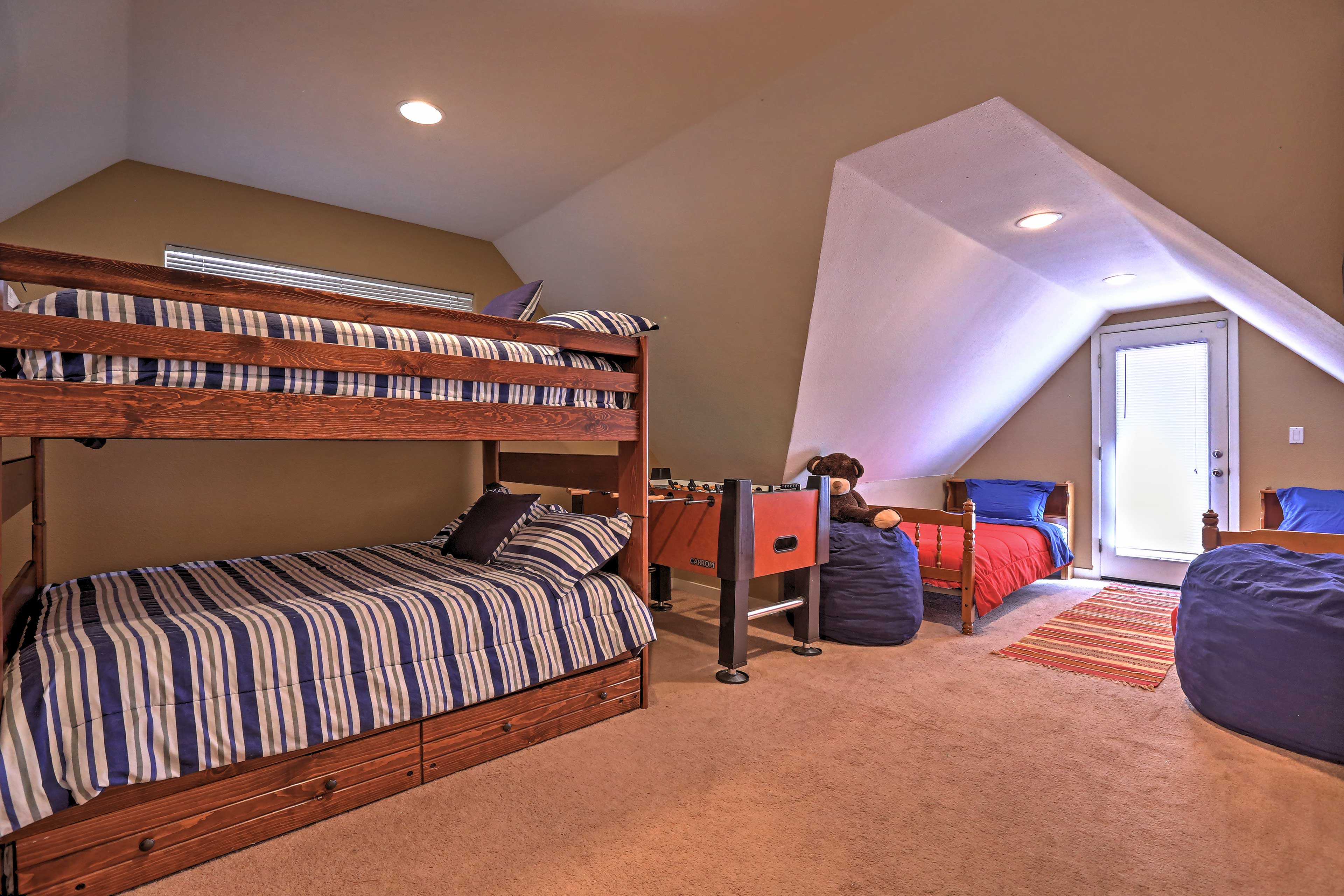 Full-over-full bunk beds, 2 twin beds, and a twin trundle bed highlight the last bedroom.
