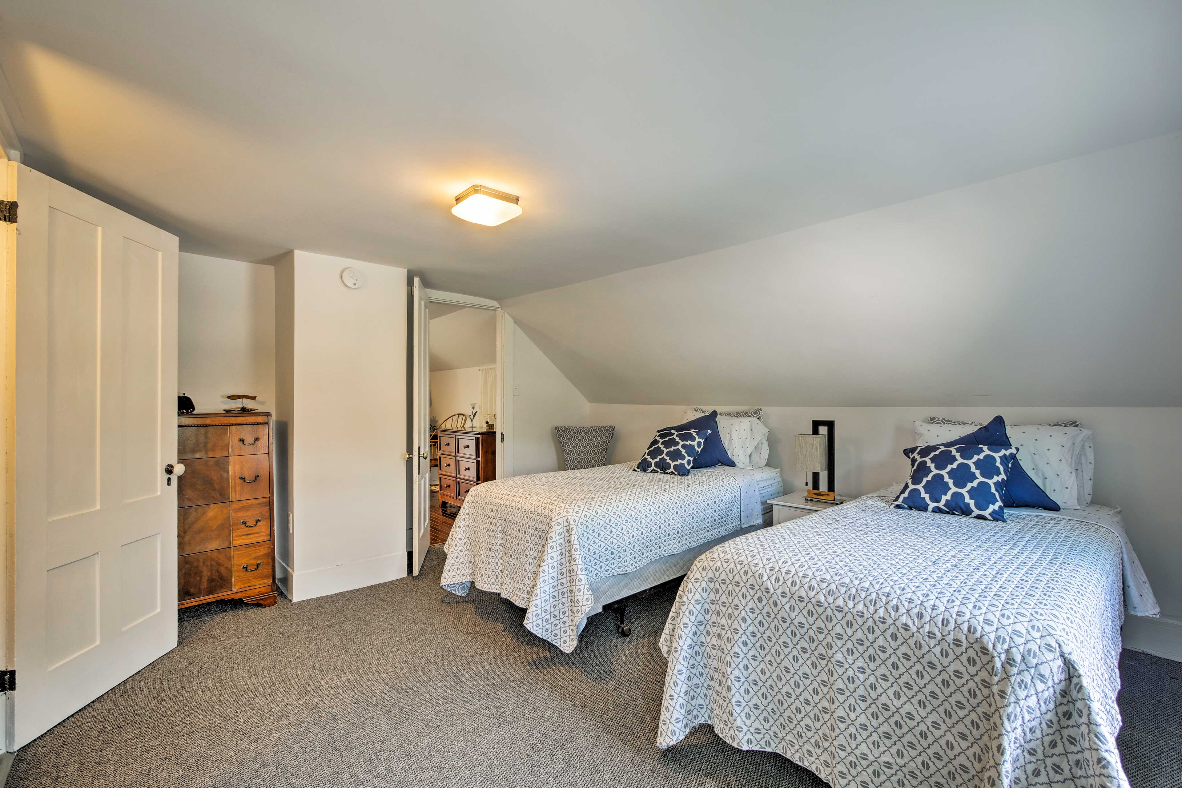 The third bedroom features a set of twin beds.