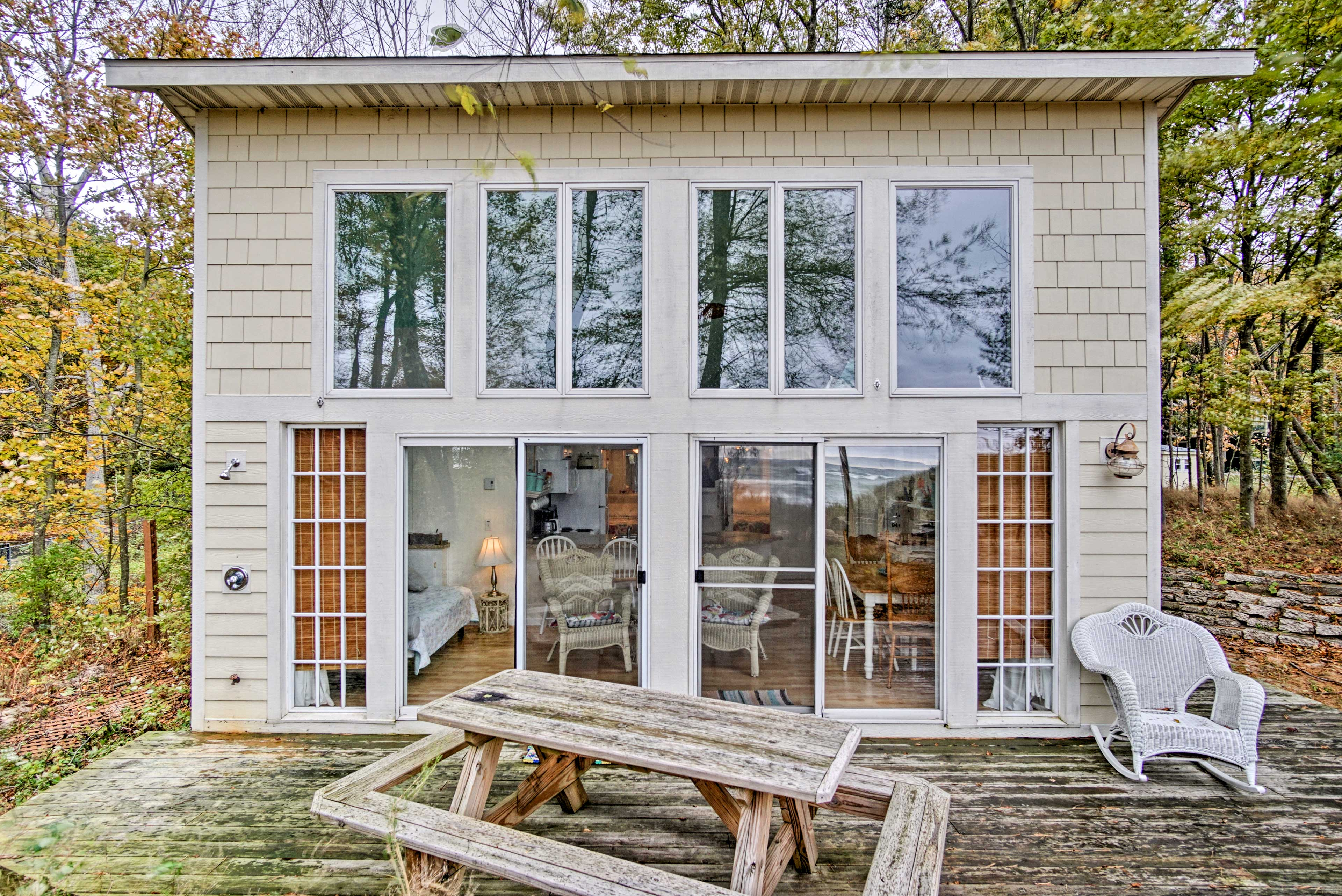 Lakefront bliss awaits you at this 2-bed, 1-bath vacation rental cottage in North Muskegon!