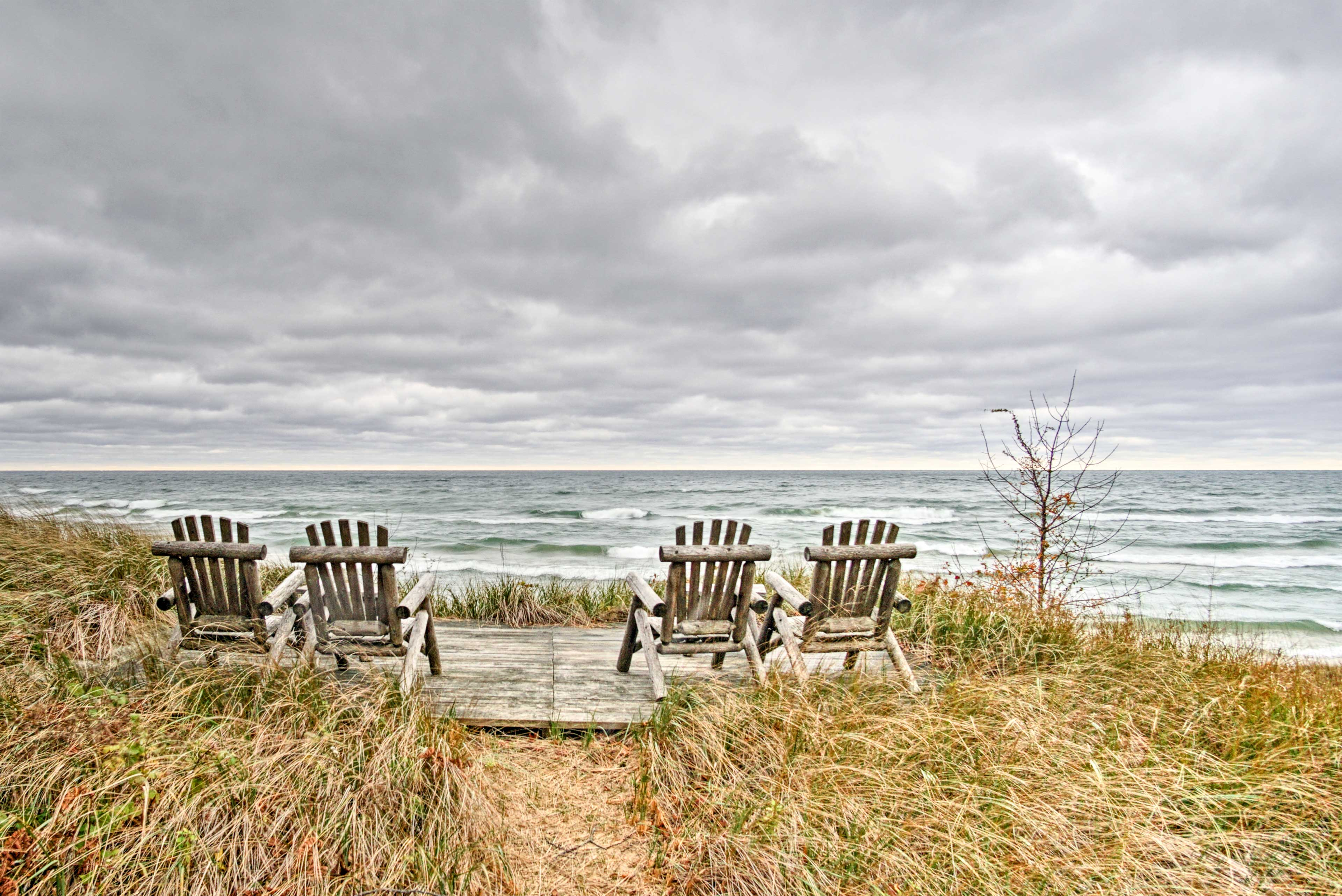 The property rests on 140 feet of beautiful Lake Michigan dunes.