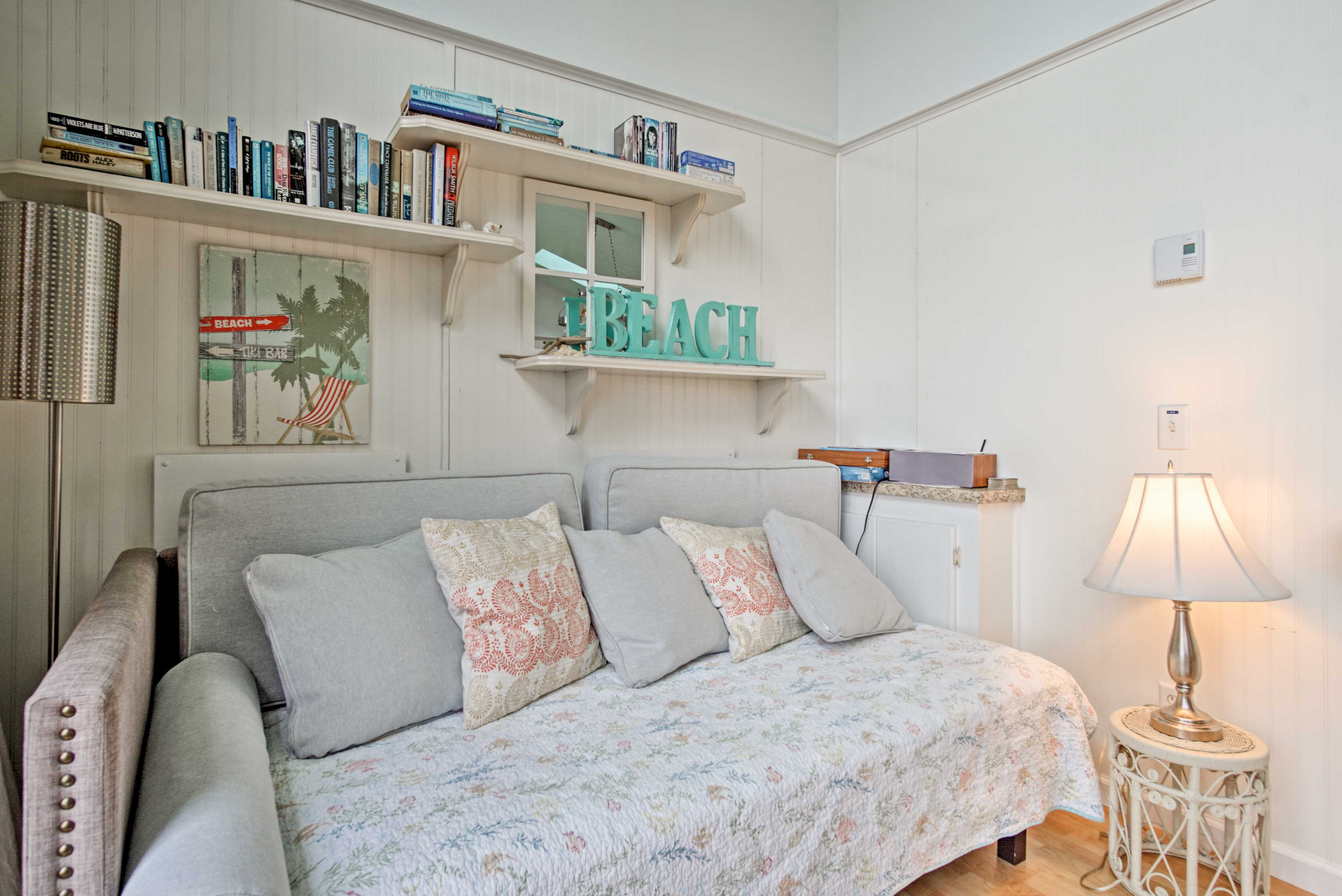 A sofa bed in the living room offers a cozy spot to read a book and get a good night's sleep!