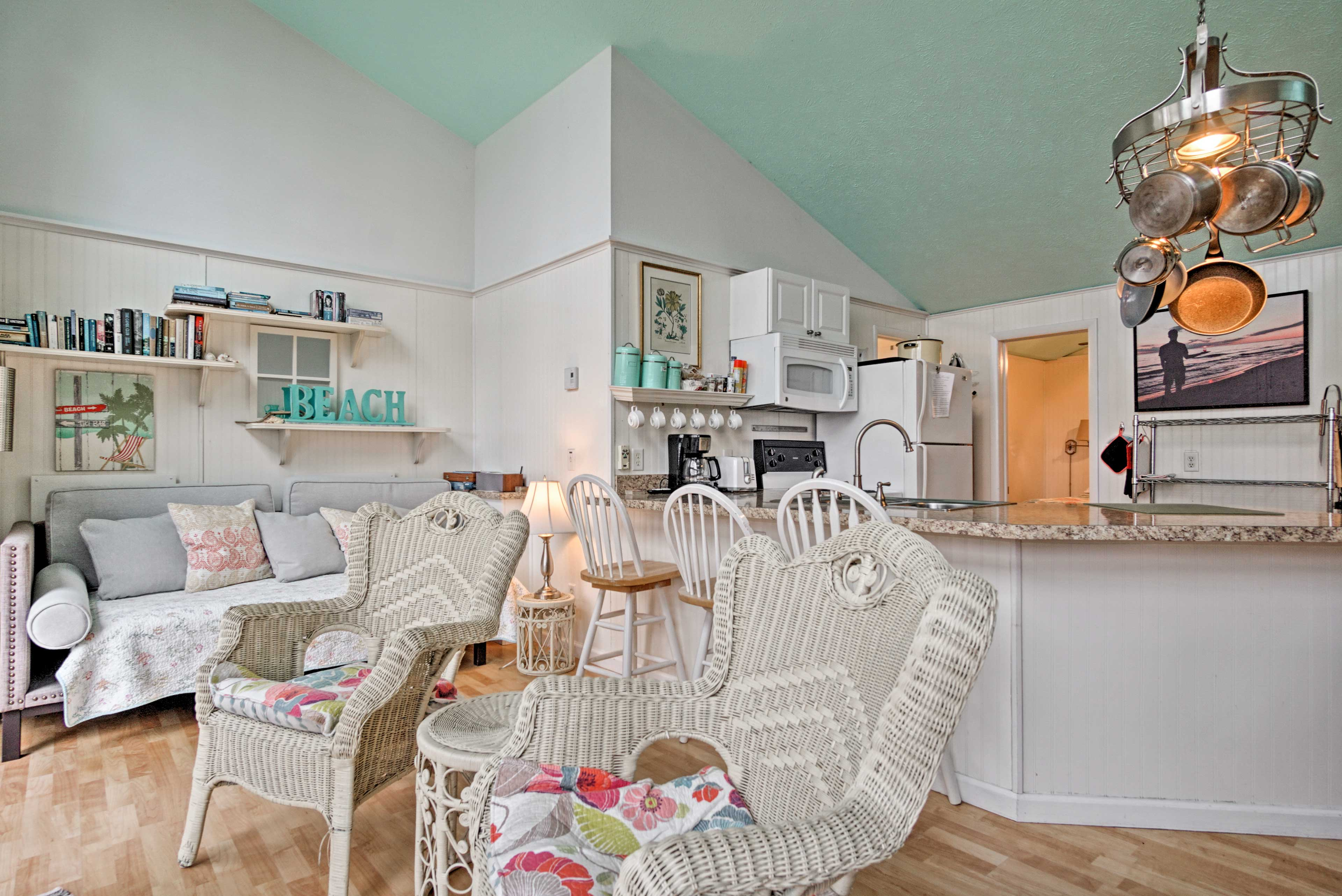 The main living area of the cottage is open and airy, inviting you to settle right in.
