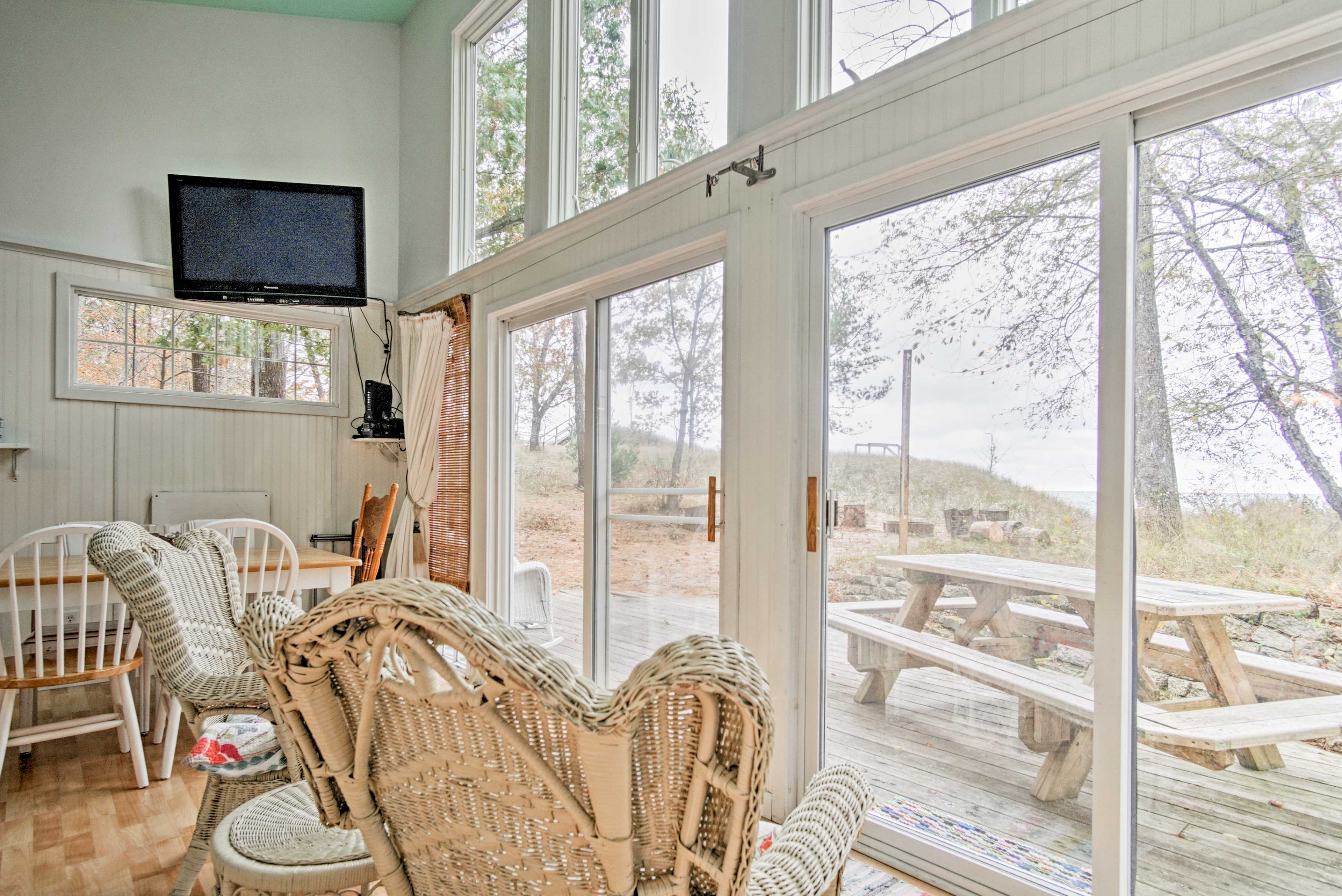 Large windows allow bright natural light to fill the cottage.