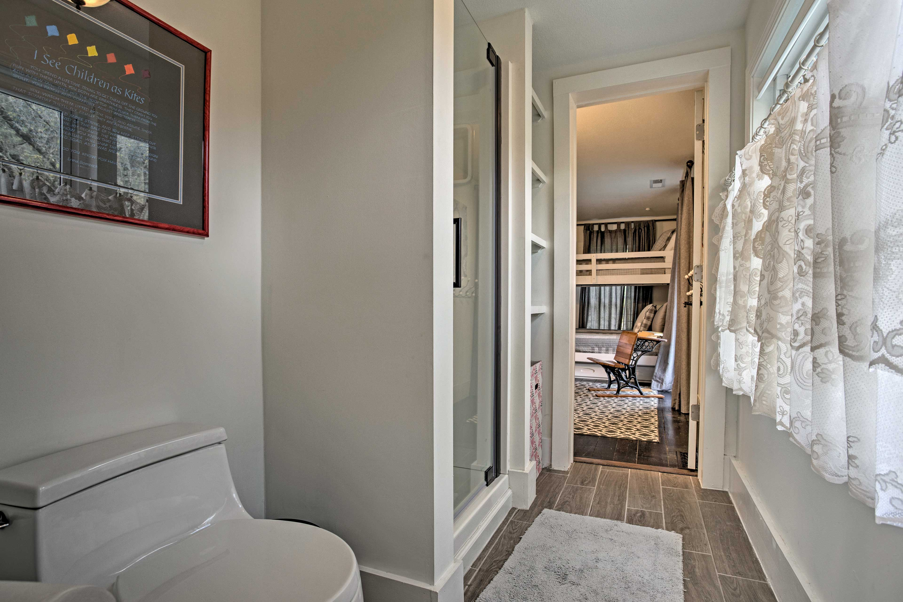 Two bedrooms enjoy access to this Jack-and-Jill bathroom.