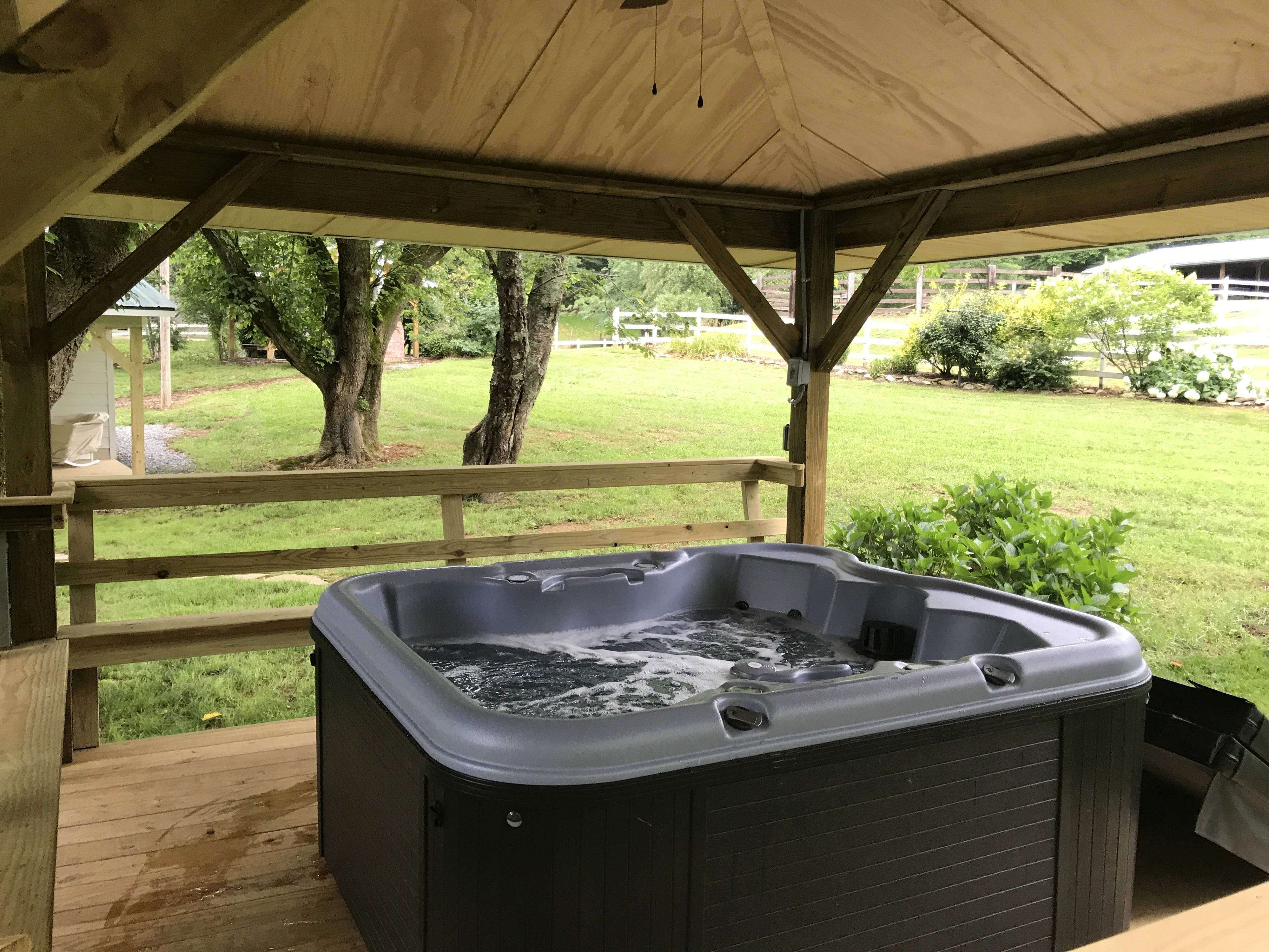 Soothe your muscles in the hot tub while reveling in the fresh air.